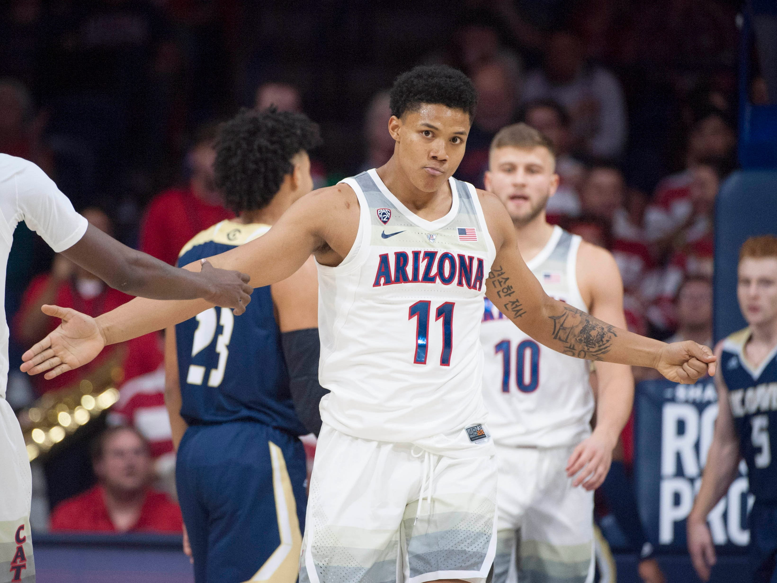 Dec 22, 2018; Tucson, AZ, USA; Arizona Wildcats forward Ira Lee (11) high fives guard Dylan Smith (3) (left) after scoring against the UC Davis Aggies during the first half at McKale Center. Mandatory Credit: Casey Sapio-USA TODAY Sports