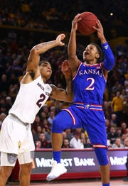 Kansas guard Charlie Moore shoots a scores past Arizona State guard Rob Edwards in the first half on Dec. 22 at Wells Fargo Arena.