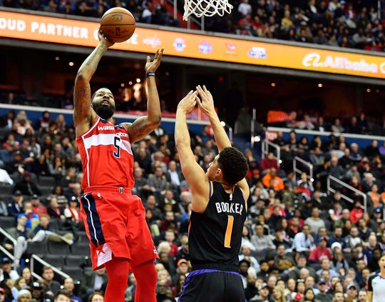 Dec 21, 2018; Washington, DC, USA; Washington Wizards forward Markieff Morris (5) shoots over Phoenix Suns guard Devin Booker (1) during the second quarter at Capital One Arena. Mandatory Credit: Brad Mills-USA TODAY Sports