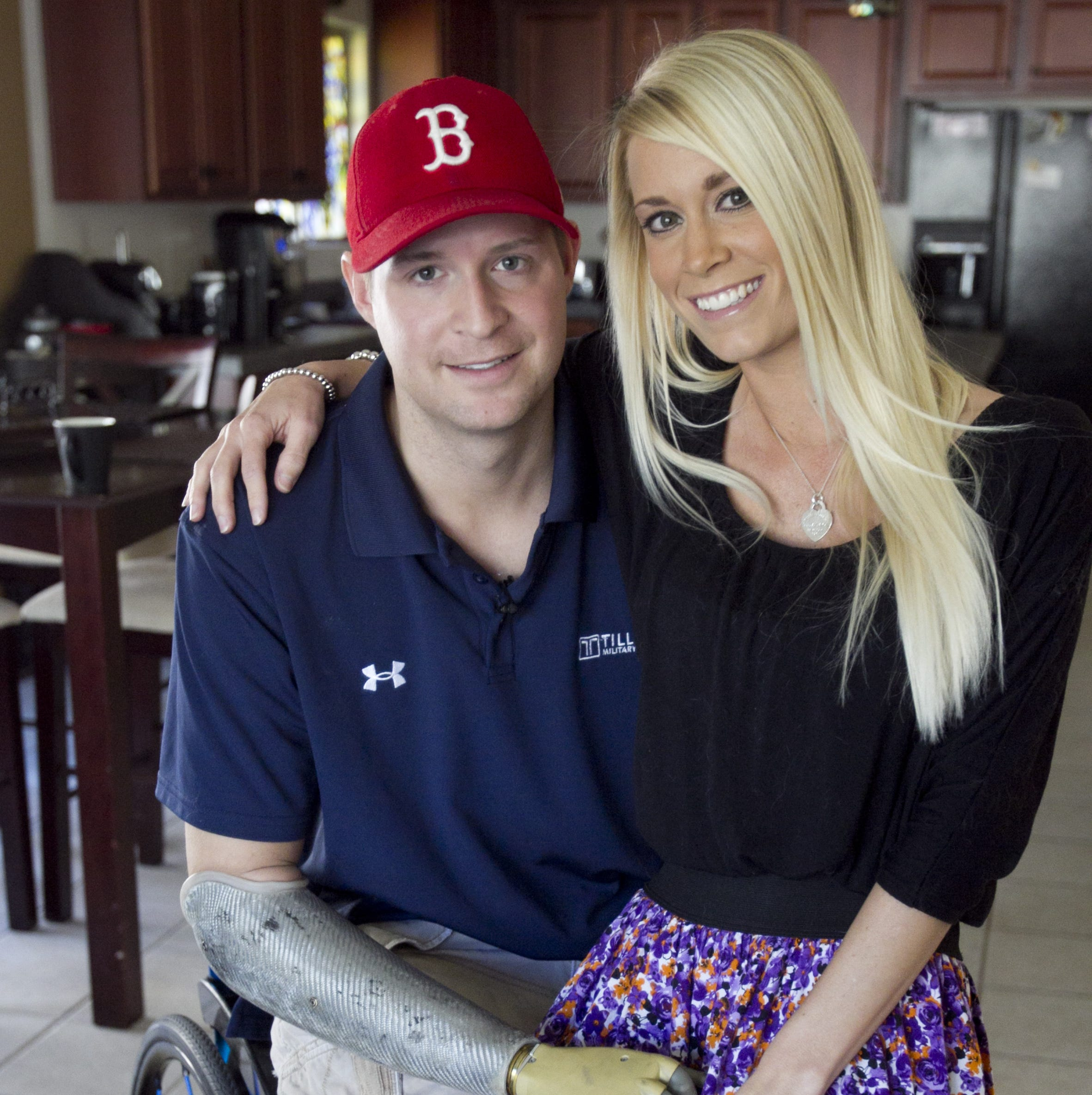 Iraq War veteran Brian Kolfage sits with his wife Ashley Kolfage in their Tucson home a 2012 file photo. He lost both legs and his right arm in Iraq.