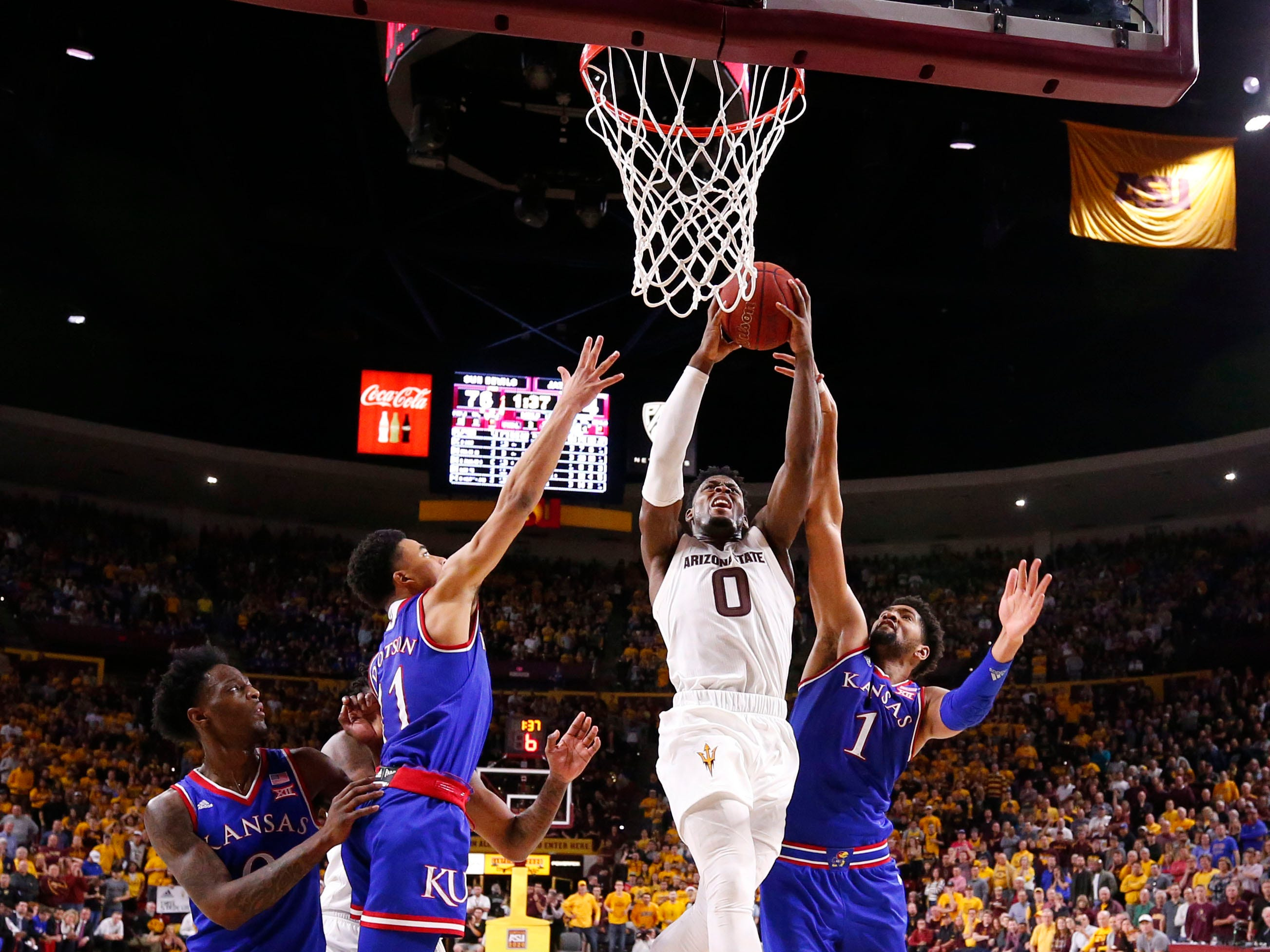 Arizona State guard Luguentz Dort drives to the basket against Kansas in the second half on Dec. 22 at Wells Fargo Arena.