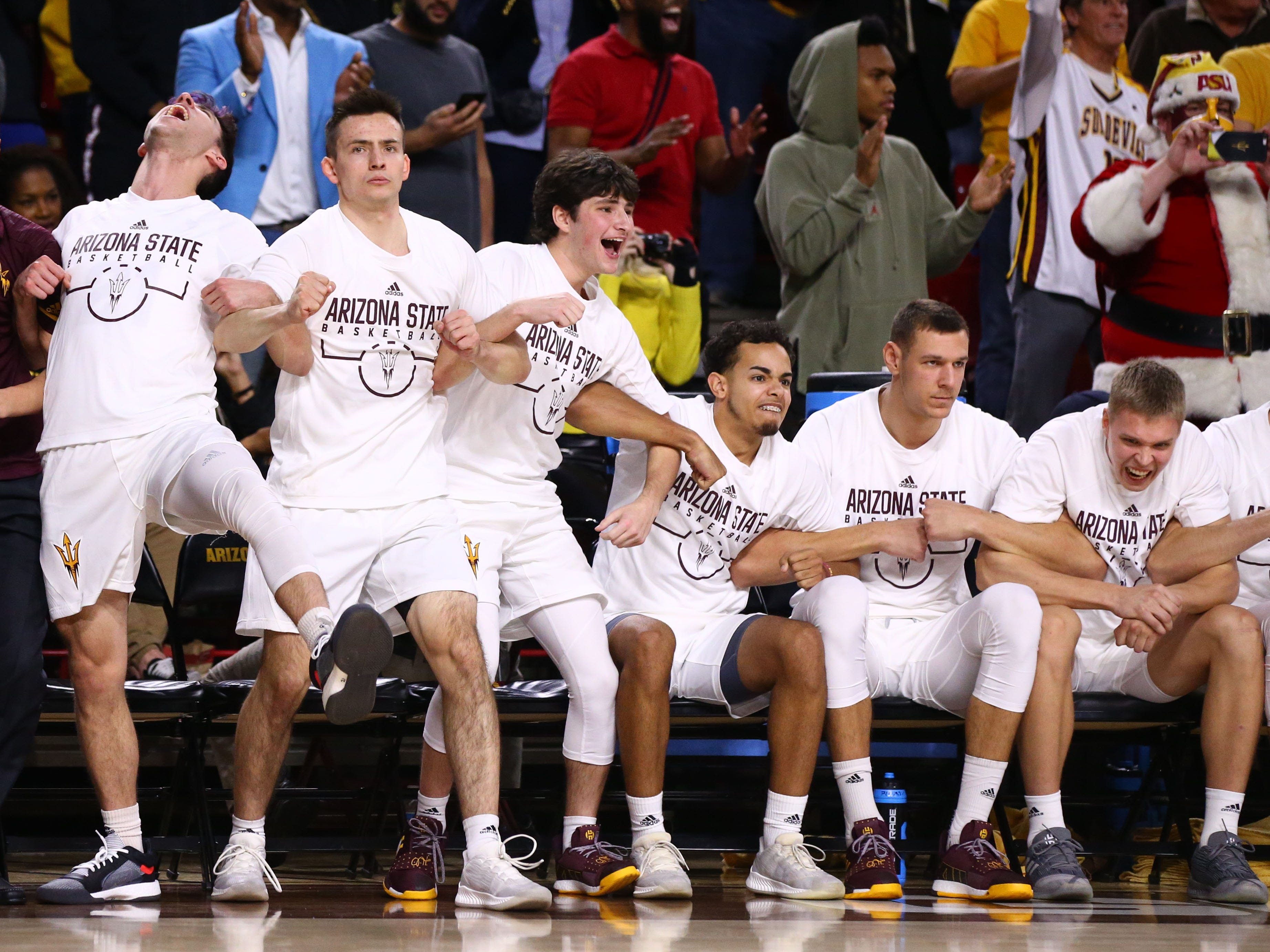 The Arizona State bench celebrates their comeback win over Kansas on Dec. 22 at Wells Fargo Arena.