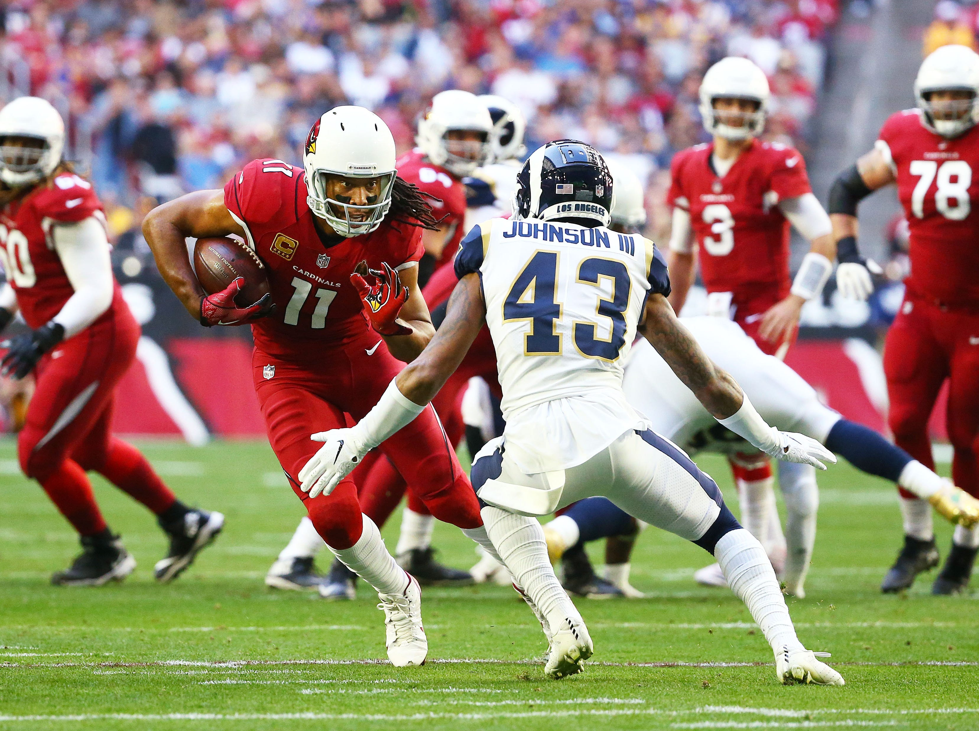 Arizona Cardinals wide receiver Larry Fitzgerald runs for a first down against the Los Angeles Rams in the first half on Dec. 23 at State Farm Stadium.