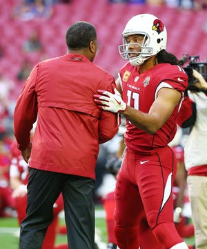 Arizona Cardinals head coach Steve Wilks greets Larry Fitzgerald for playing the Los Angeles Rams on Dec. 23 at State Farm Stadium.
