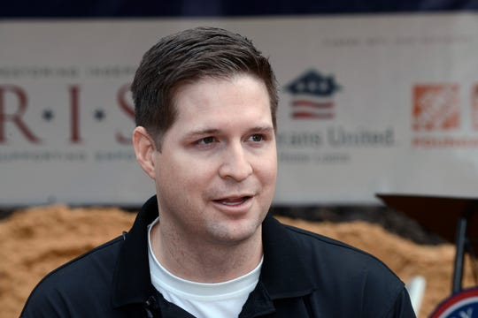 In this Jan. 14, 2016, photo, retired U.S. Air Force Senior Airman Brian Kolfage, speaks with the media during a 2016 groundbreaking ceremony for a new home he and his family were receiving through the Gary Sinise Foundation's RISE program in Sandestin, Florida. Kolfage's GoFundMe for the border wall has raised more than $16 million of its $1 billion goal.