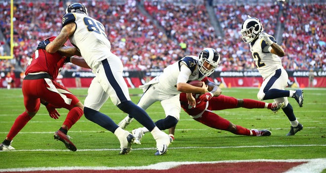 Los Angeles Rams quarterback Jared Goff runs for a touchdown against the Arizona Cardinals in the first half on Dec. 23 at State Farm Stadium.