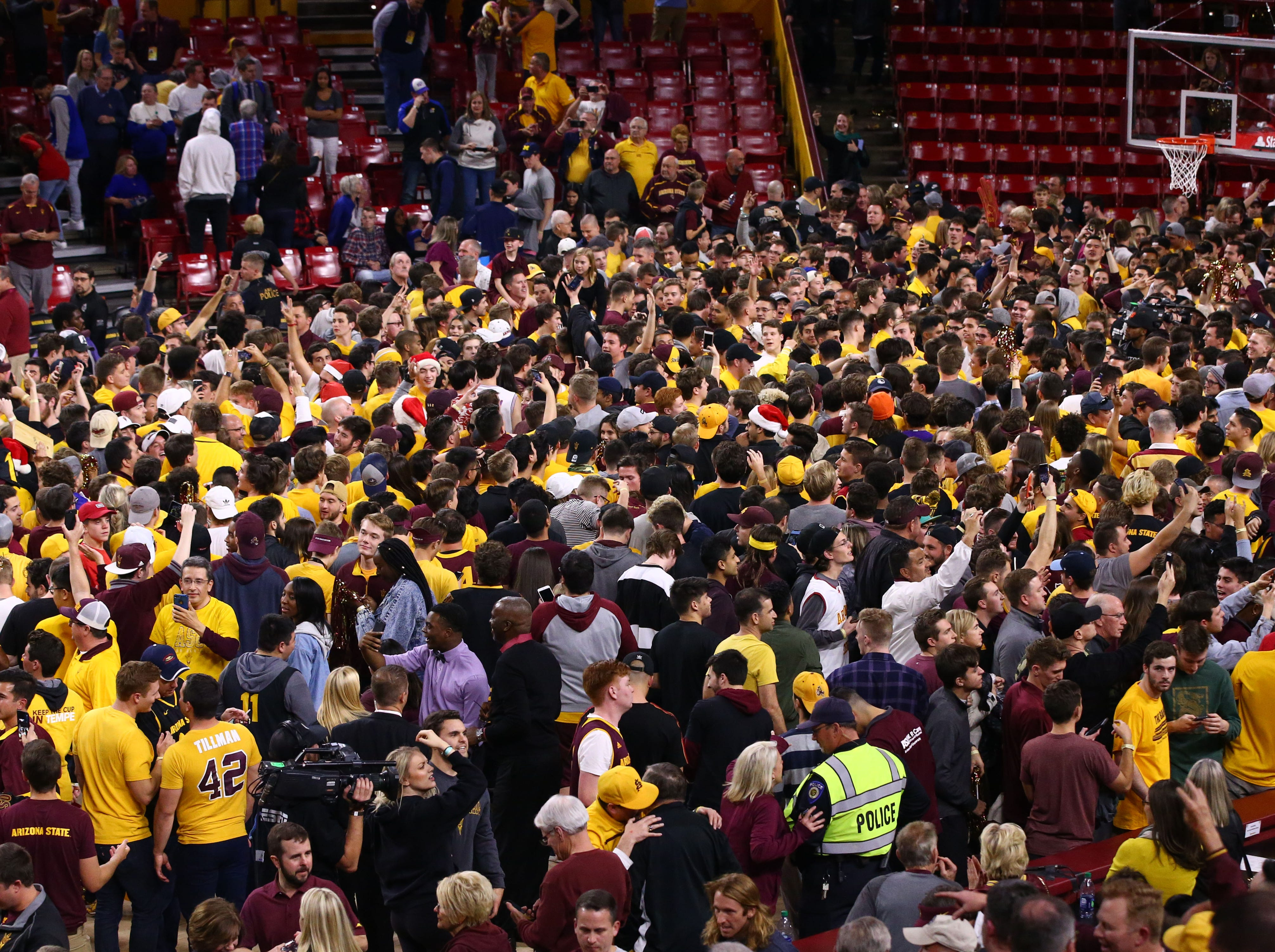 Arizona State fans rush the court after defeating Kansas on Dec. 22 at Wells Fargo Arena.