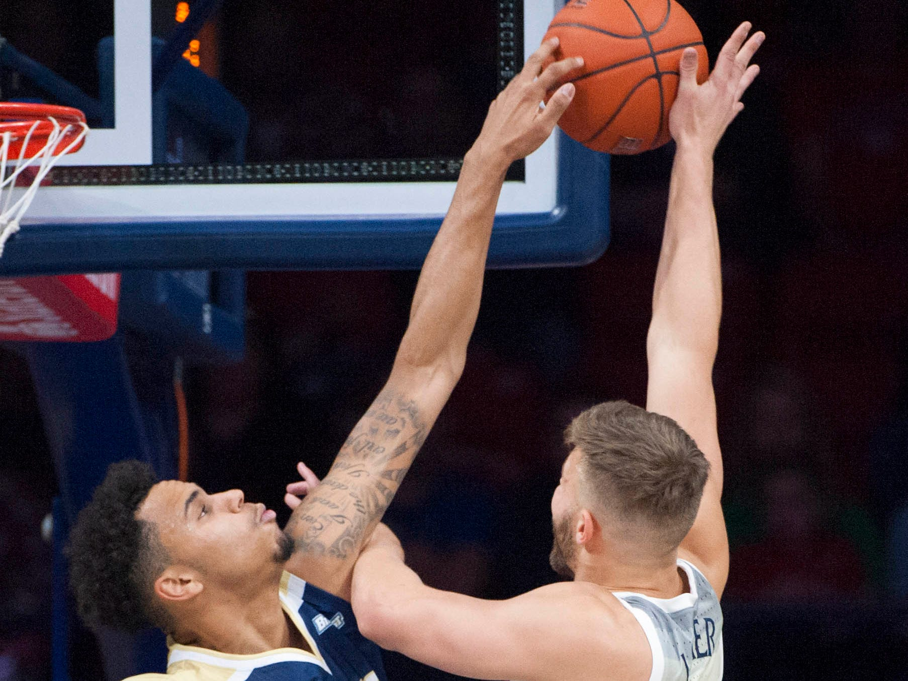 Dec 22, 2018; Tucson, AZ, USA; UC Davis Aggies guard Caleb Fuller (11) blocks the shot of Arizona Wildcats forward Ryan Luther (10) during the first half at McKale Center. Mandatory Credit: Casey Sapio-USA TODAY Sports