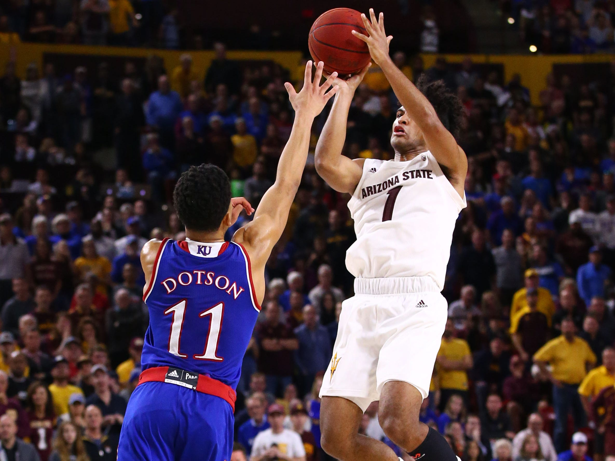 Arizona State guard Remy Martin makes the final basket of the game over Kansas guard Devon Dotson in the second