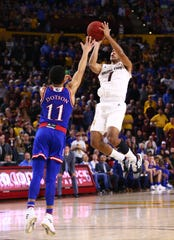 Arizona State guard Remy Martin makes the final basket of the game over Kansas guard Devon Dotson in the second half on Dec. 22 at Wells Fargo Arena.