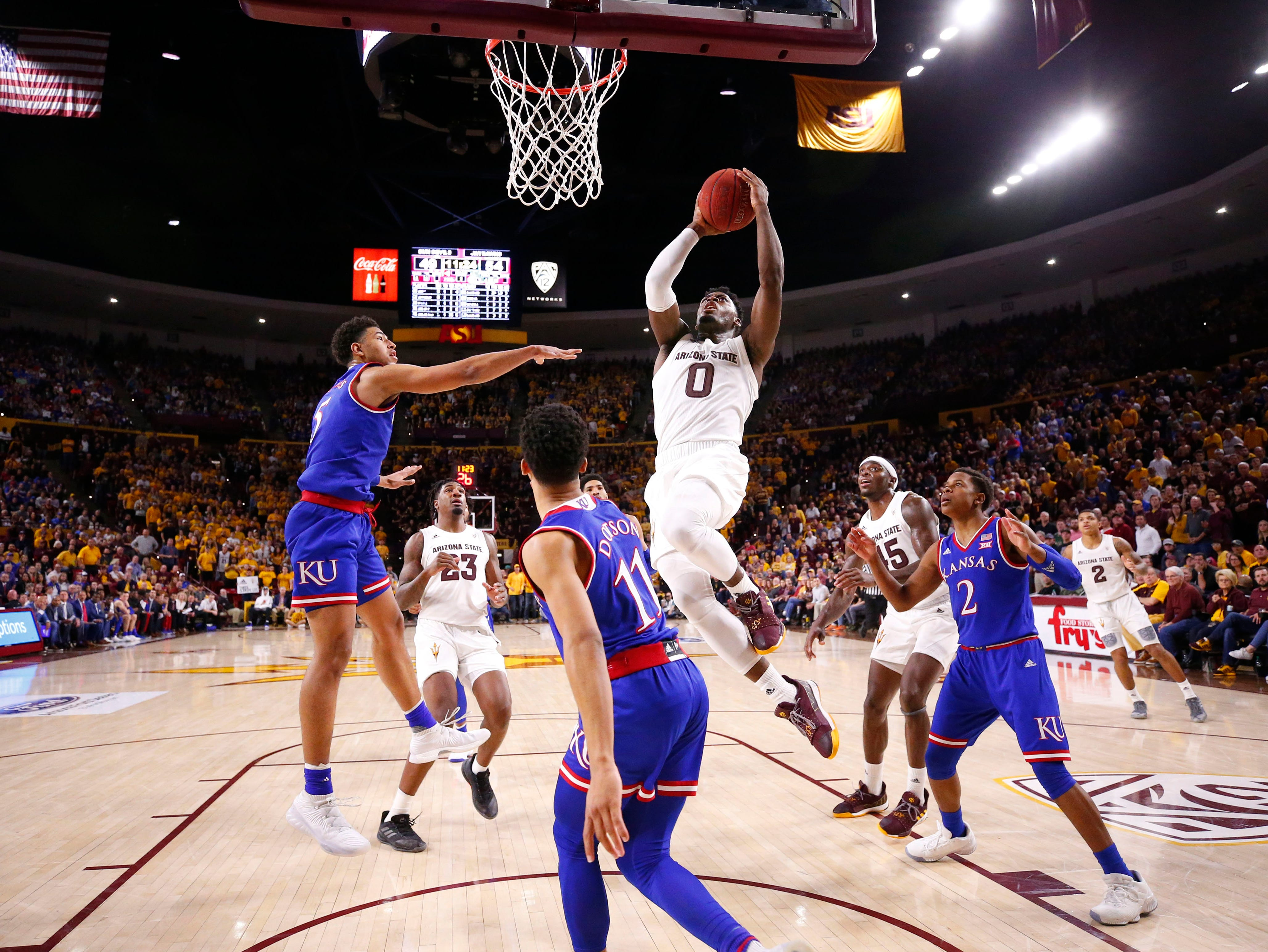 Arizona State guard Luguentz Dort dives to the basket against Kansas in the second half on Dec. 22 at Wells Fargo Arena.
