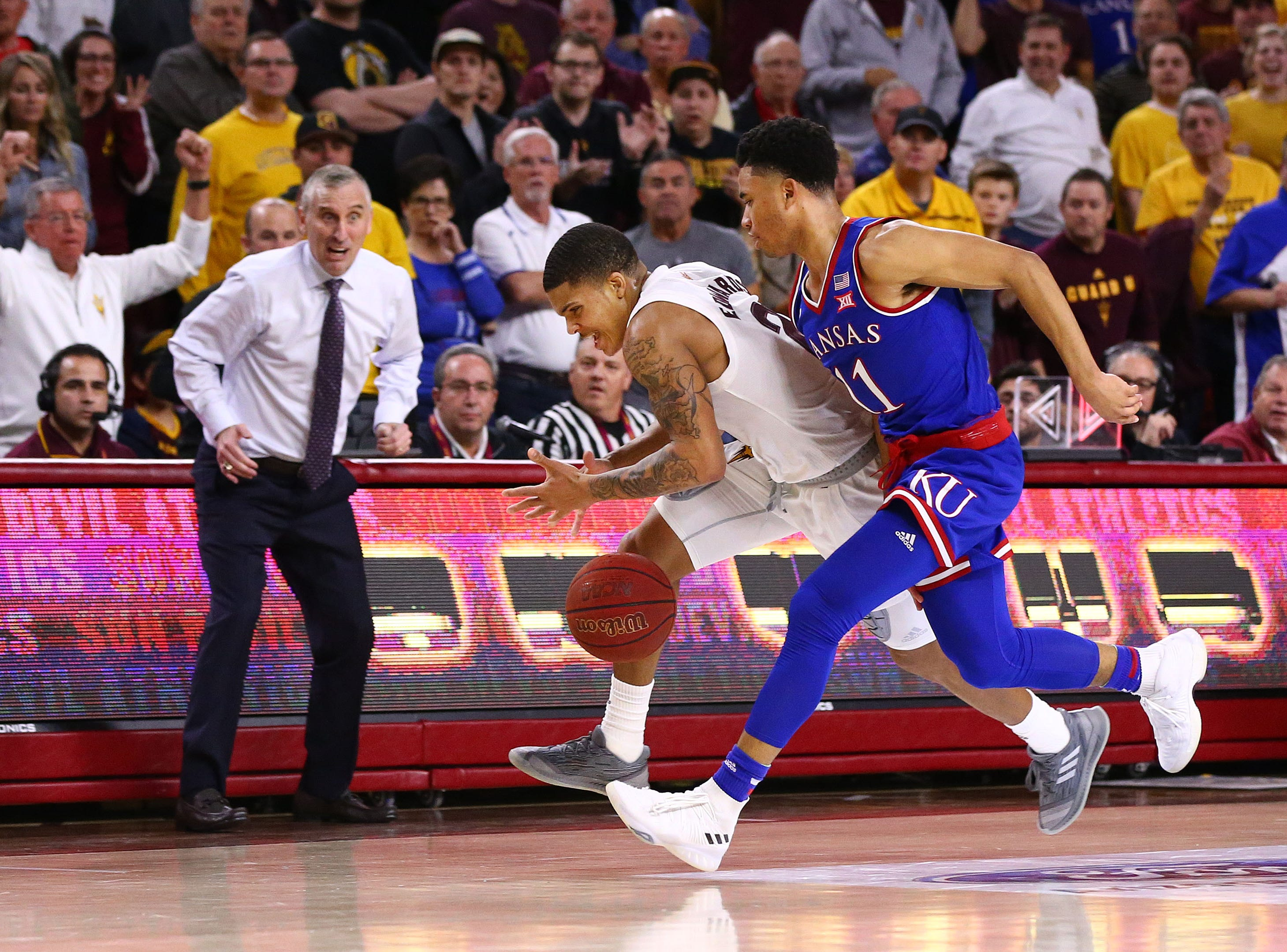 Arizona State recovers a loose ball as Rob Edwards and Kansas guard Devon Dotson chase late in the second half on Dec. 22 at Wells Fargo Arena.
