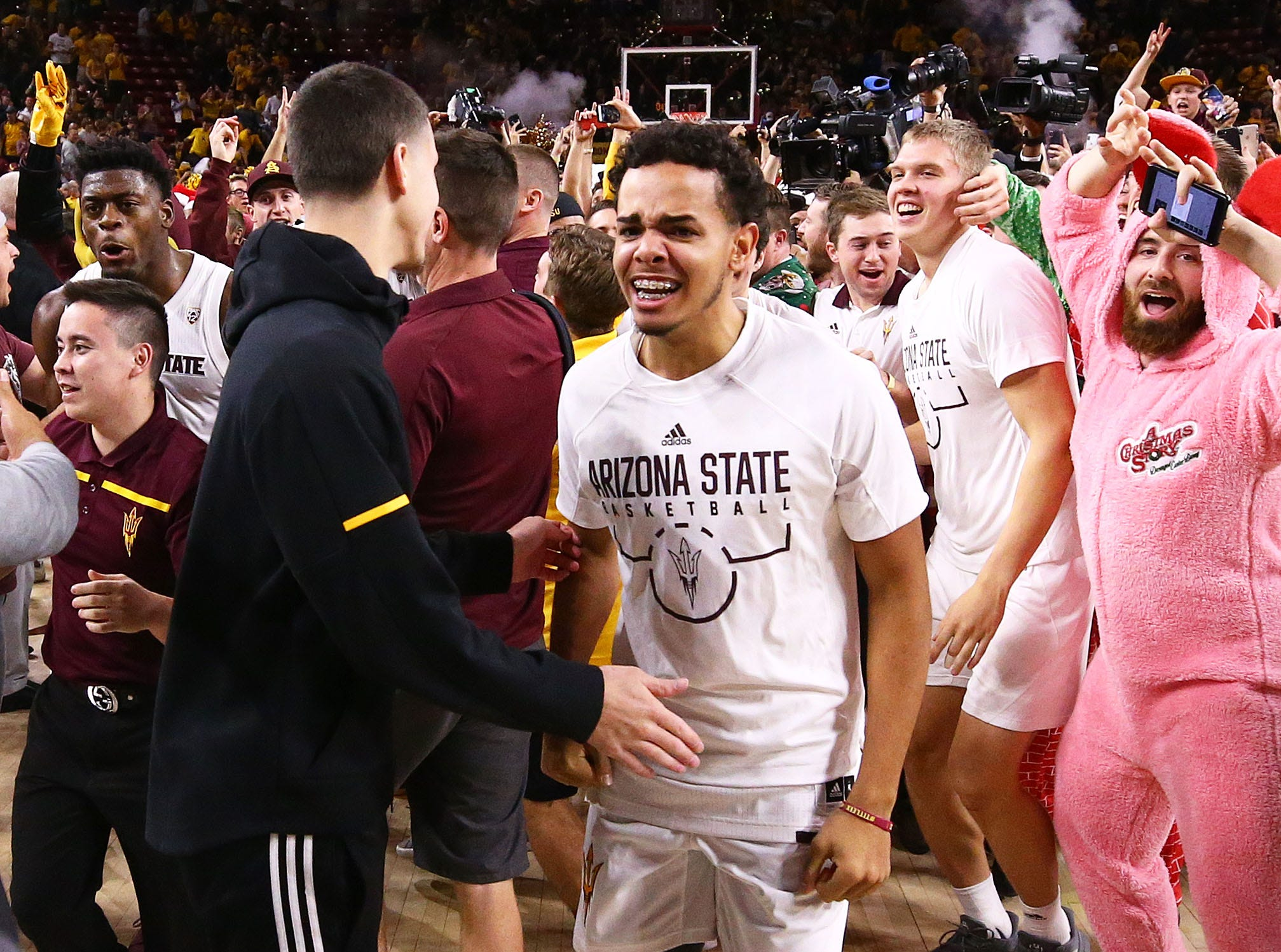 Arizona State fans rush the court after the Sun Devils beat Kansas on Dec. 22 at Wells Fargo Arena.