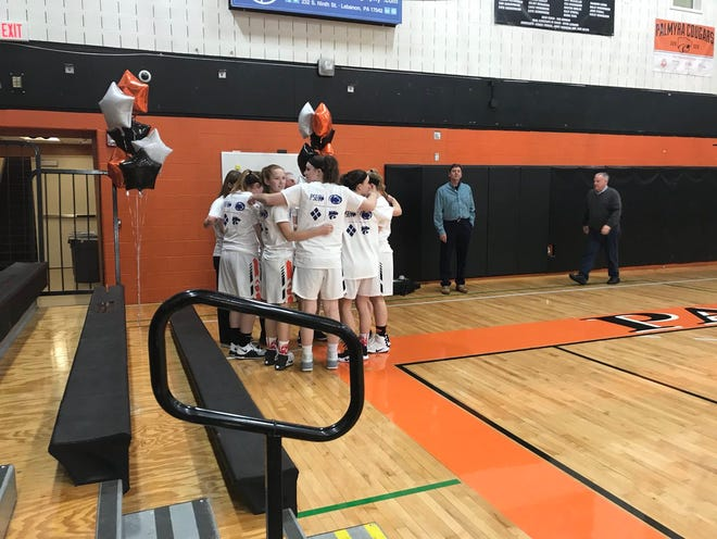 The Palmyra girls basketball team huddles up before Saturday's 43-26 Hall of Fame night win over Cedar Crest.