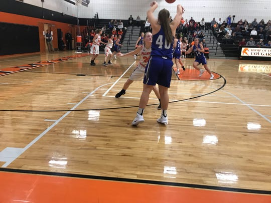 Cedar Crest's Kaitlin Kline looks to pass to open teammate as Palmyra's Jessica St. Clair defends.