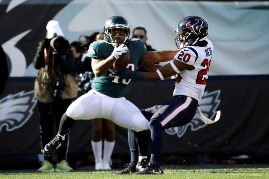 Philadelphia Eagles' Darren Sproles, left, breaks free from Houston Texans' Justin Reid on a touchdown catch during the first half of an NFL football game, Sunday, Dec. 23, 2018, in Philadelphia. (AP Photo/Matt Rourke)