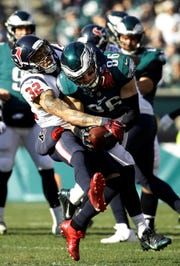Philadelphia Eagles' Zach Ertz (86) tries to break a tackle from Houston Texans' Tyrann Mathieu (32) during the first half of an NFL football game, Sunday, Dec. 23, 2018, in Philadelphia. (AP Photo/Matt Rourke)