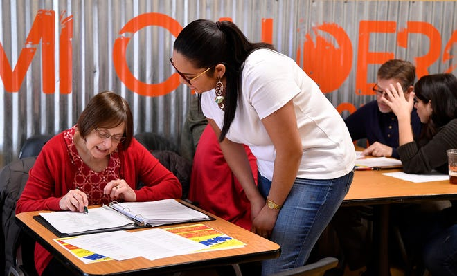Thais Carrero of York XL, right, helps Irene Ritson during the final Spanish language class of their first 8-week program, Sunday, December 23, 2018.John A. Pavoncello photo