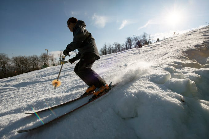 A skier makes a turn while skiing down minuteman slope on opening day at Roundtop Mountain Resort Sunday December 23, 2018.