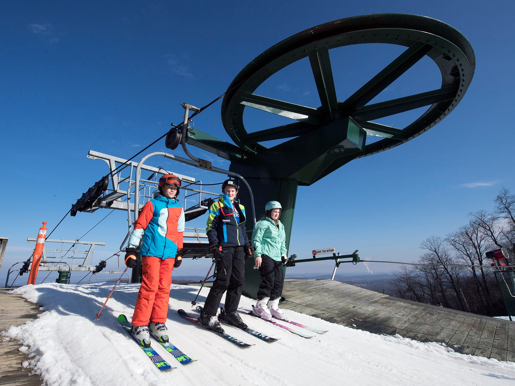 Skiers come off the lift at Miniteman beneath a cloudless sky at Roundtop Mountain Resort Sunday December 23, 2018.