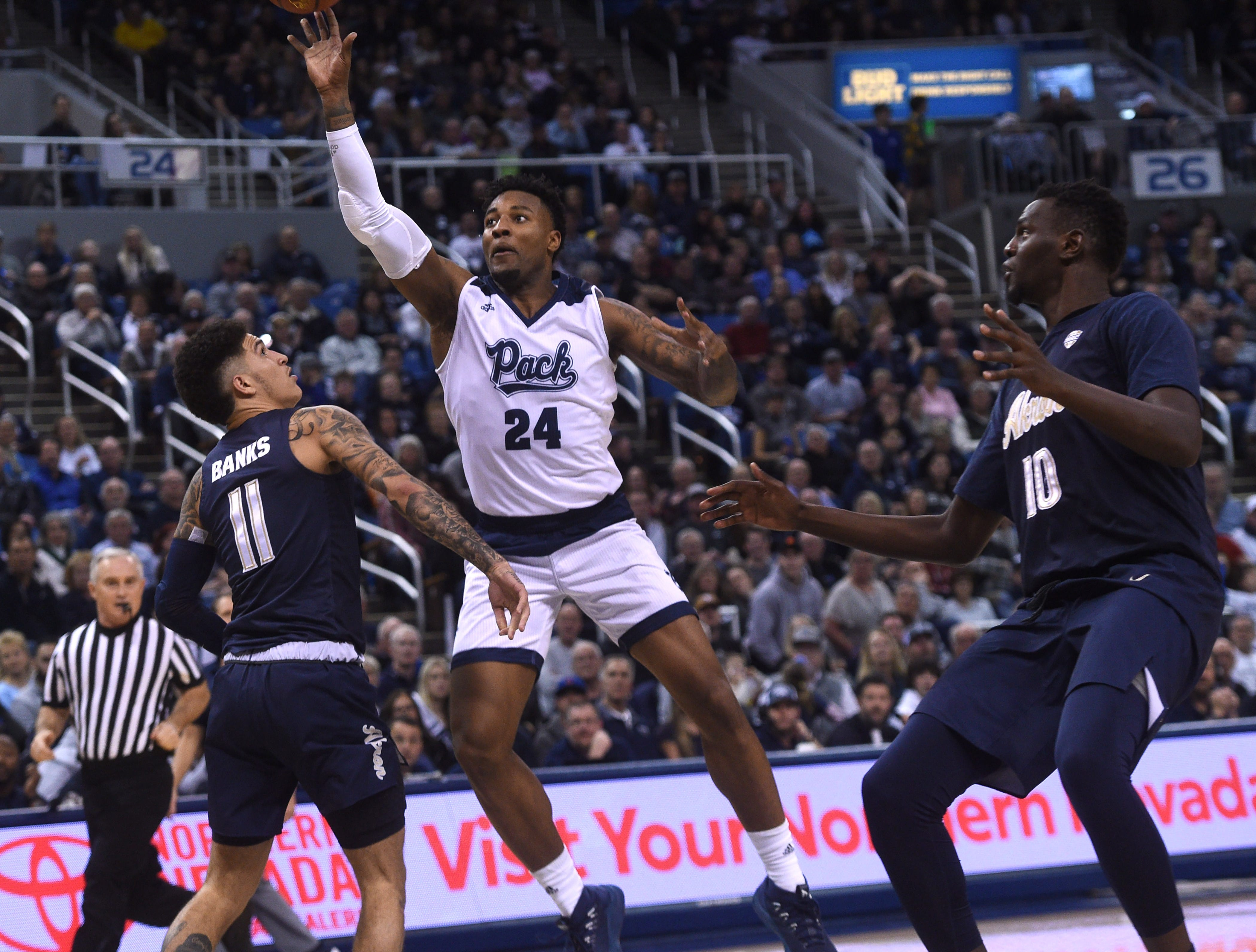 Nevada's Jordan Caroline (24) shoots while taking on Akron during their basketball game at Lawlor Events Center in Reno on Dec. 22, 2018.