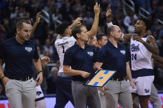 Eric Musselman and the Pack coaching staff watch the action against Akron at Lawlor Events Center.