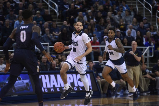 Caleb Martin (10), Jordan Caroline and the Wolf Pack basketball team begin the 2019 Mountain West season Wednesday night against Utah State.