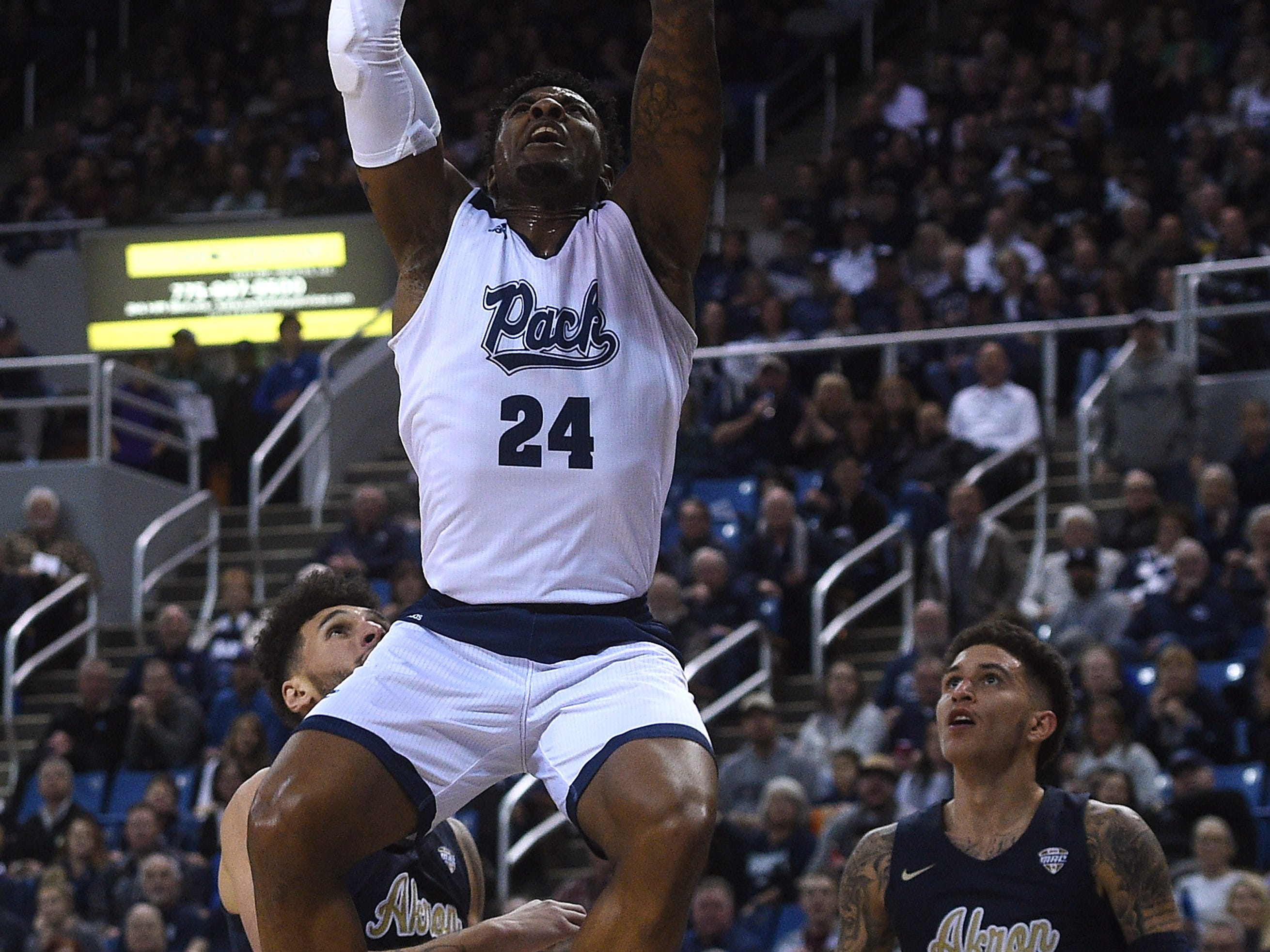 Nevada's Jordan Caroline (24) dunks while taking on Akron during their basketball game at Lawlor Events Center in Reno on Dec. 22, 2018.