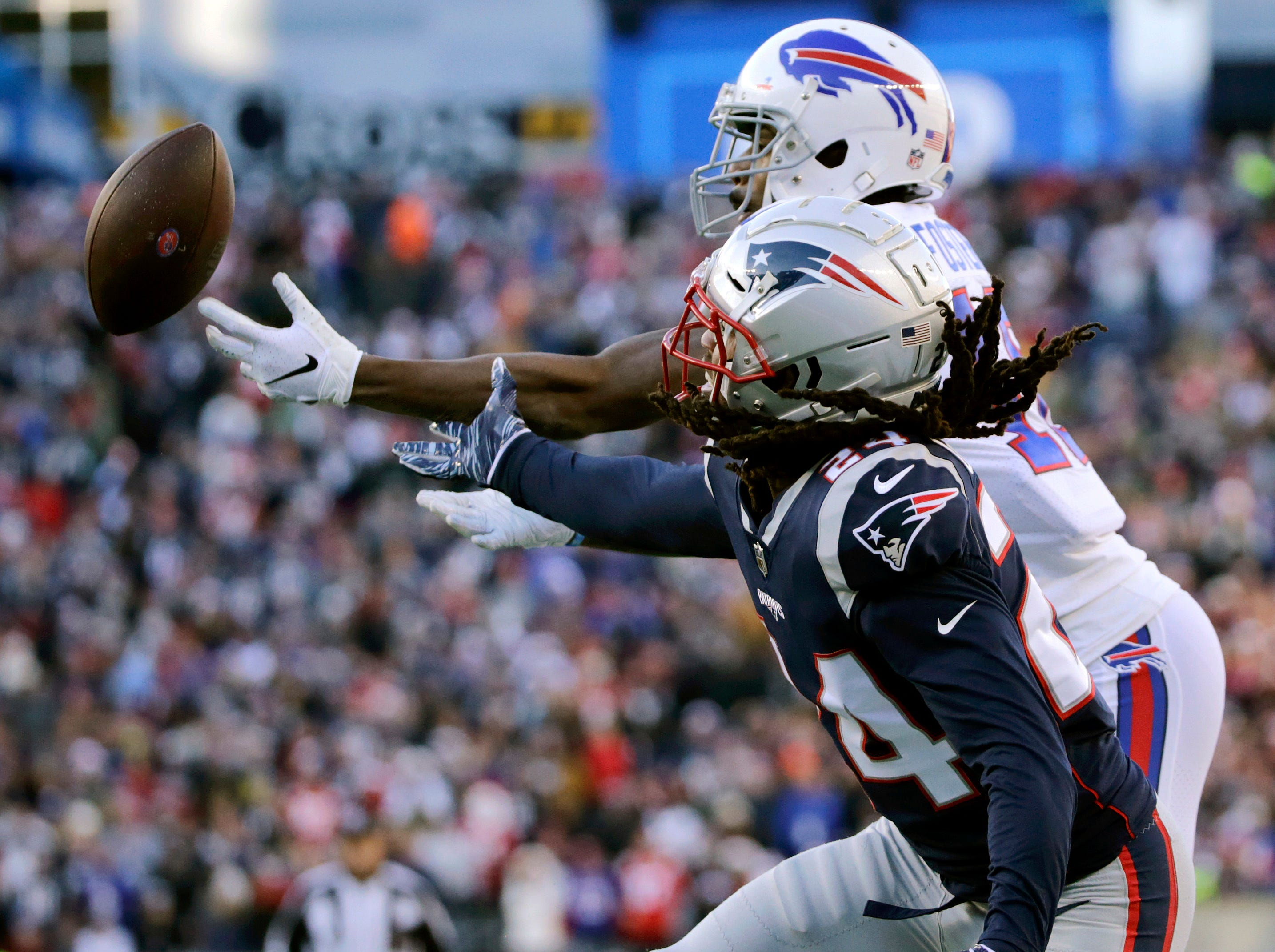 New England Patriots defensive back Stephon Gilmore, front, breaks up a pass in the end zone intended for Buffalo Bills wide receiver Robert Foster, rear, during the first half of an NFL football game, Sunday, Dec. 23, 2018, in Foxborough, Mass. (AP Photo/Elise Amendola)