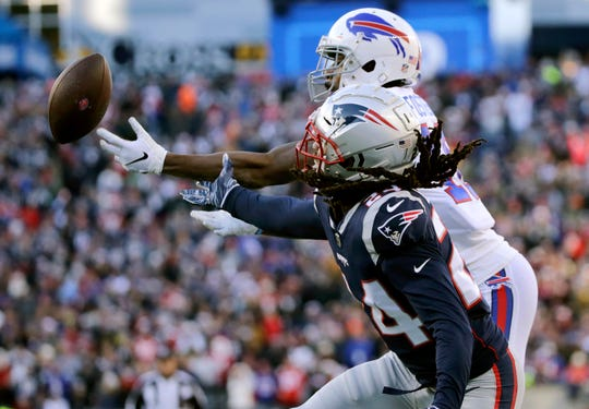 New England Patriots defensive back Stephon Gilmore, front, breaks up a pass in the end zone intended for Buffalo Bills wide receiver Robert Foster, rear, during the first half of an NFL football game, Sunday, Dec. 23, 2018, in Foxborough, Mass.