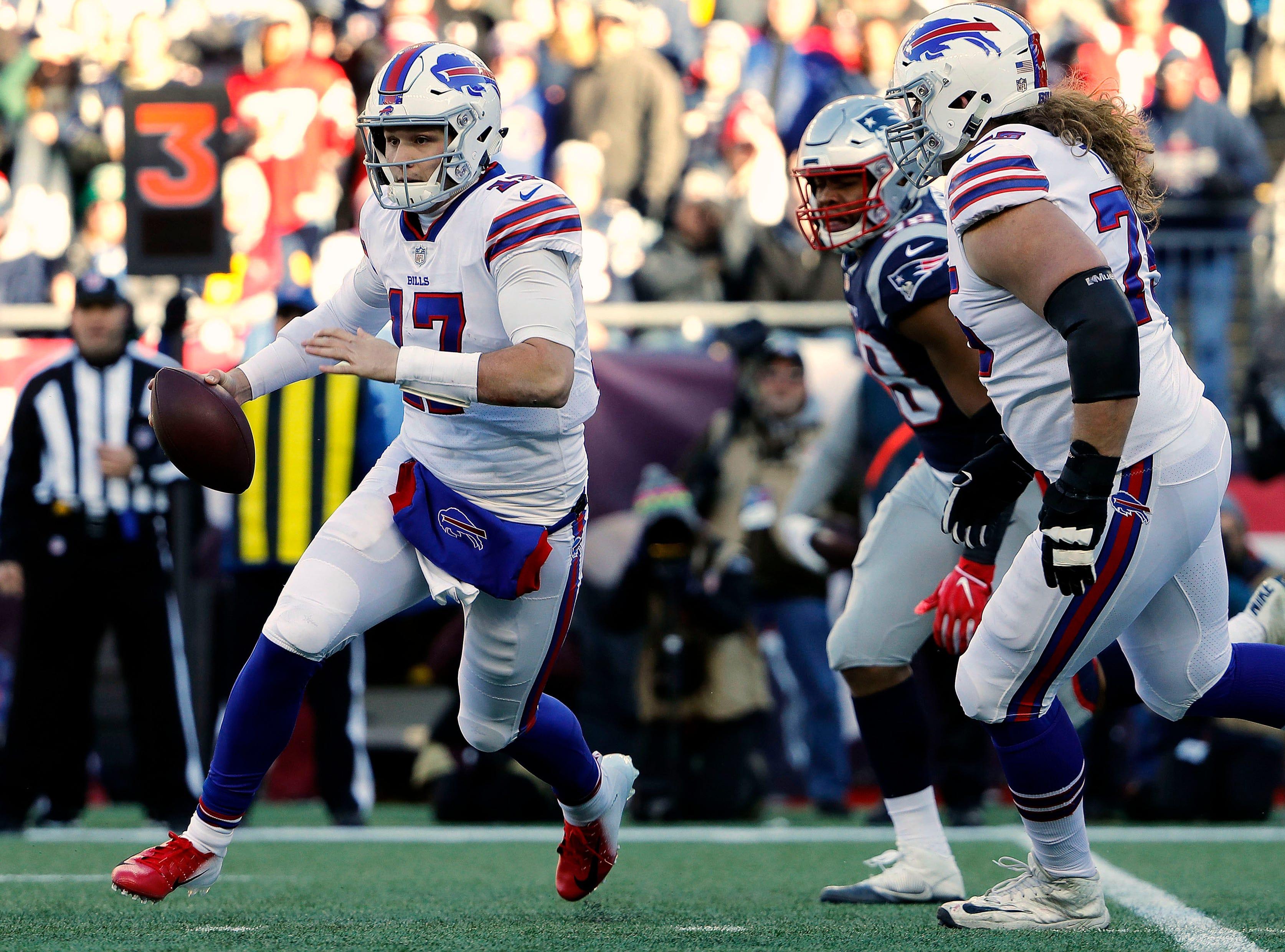 Dec 23, 2018; Foxborough, MA, USA; Buffalo Bills quarterback Josh Allen (17) runs against the New England Patriots during the first quarter at Gillette Stadium. Mandatory Credit: Winslow Townson-USA TODAY Sports