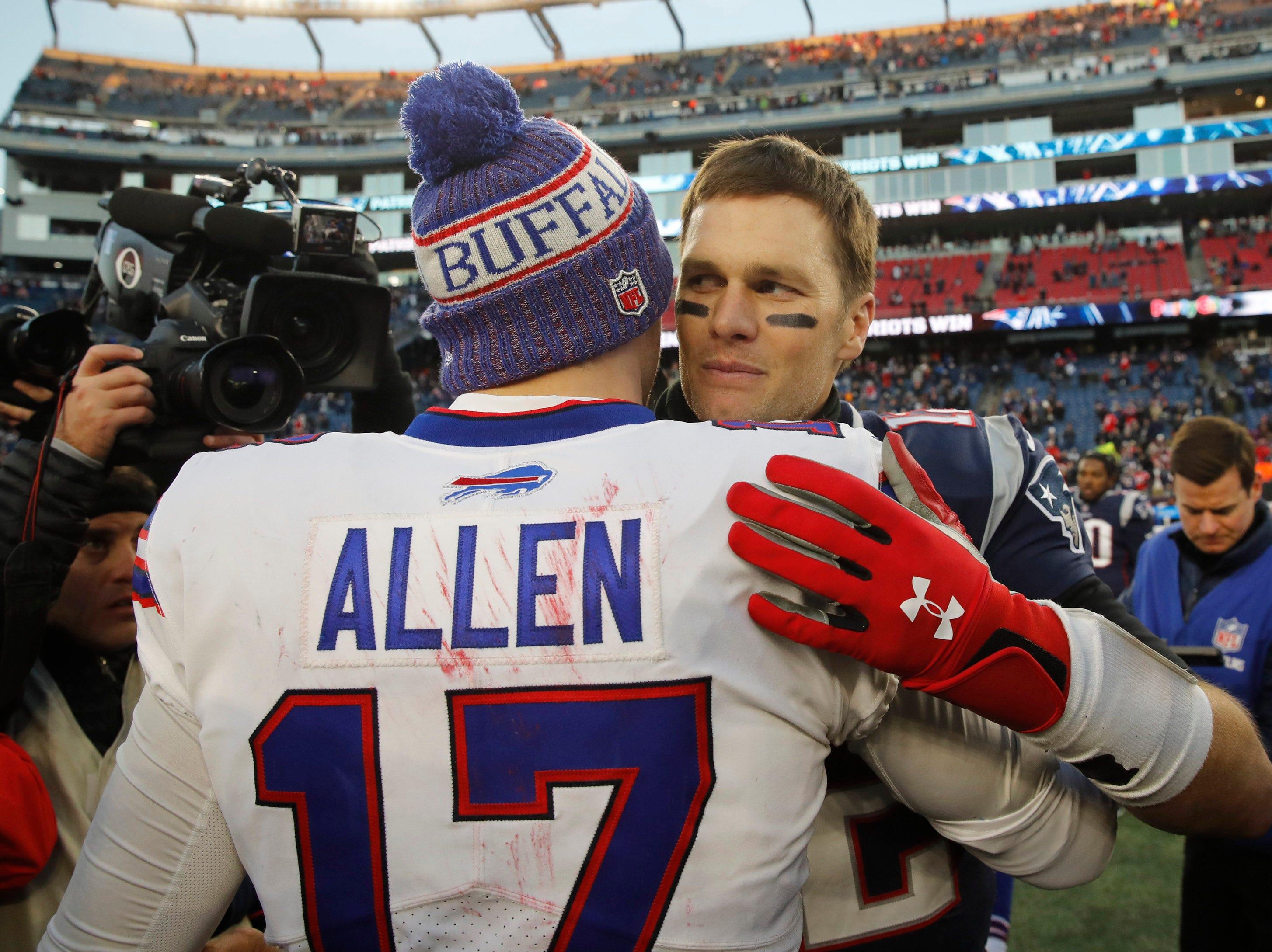 Dec 23, 2018; Foxborough, MA, USA; New England Patriots quarterback Tom Brady (12) meets Buffalo Bills quarterback Josh Allen (17) after the game at Gillette Stadium. Patriots defeated the Bills 24-12. Mandatory Credit: David Butler II-USA TODAY Sports
