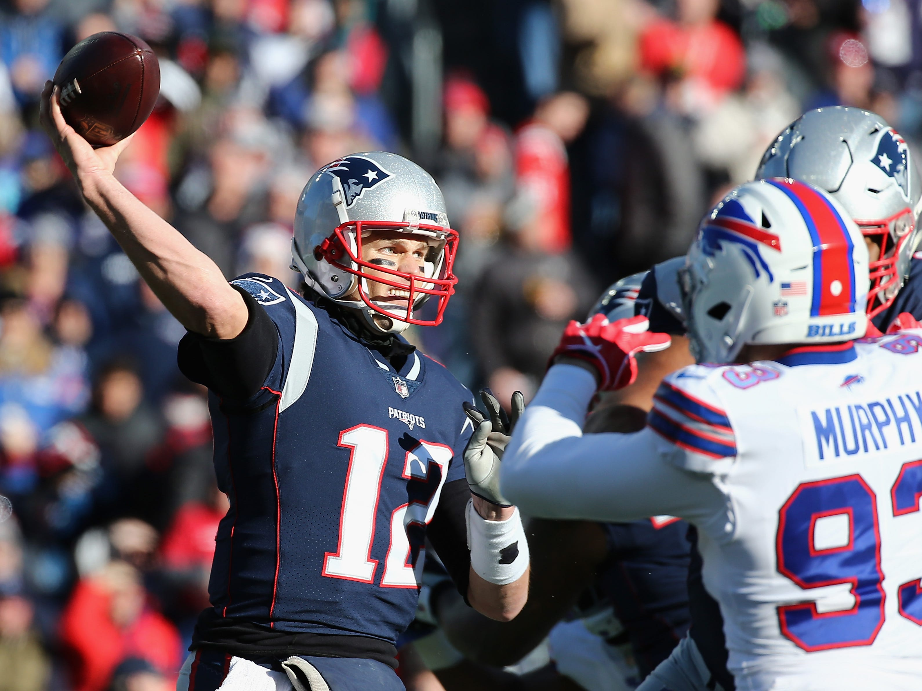 FOXBOROUGH, MA - DECEMBER 23:  Tom Brady #12 of the New England Patriots throws a pass during the first half against the Buffalo Bills at Gillette Stadium on December 23, 2018 in Foxborough, Massachusetts.  (Photo by Jim Rogash/Getty Images)