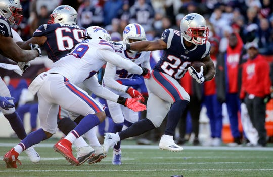 New England Patriots running back Sony Michel, right, runs from Buffalo Bills linebacker Tremaine Edmunds, left, during the first half of an NFL football game, Sunday, Dec. 23, 2018, in Foxborough, Mass. (AP Photo/Elise Amendola)