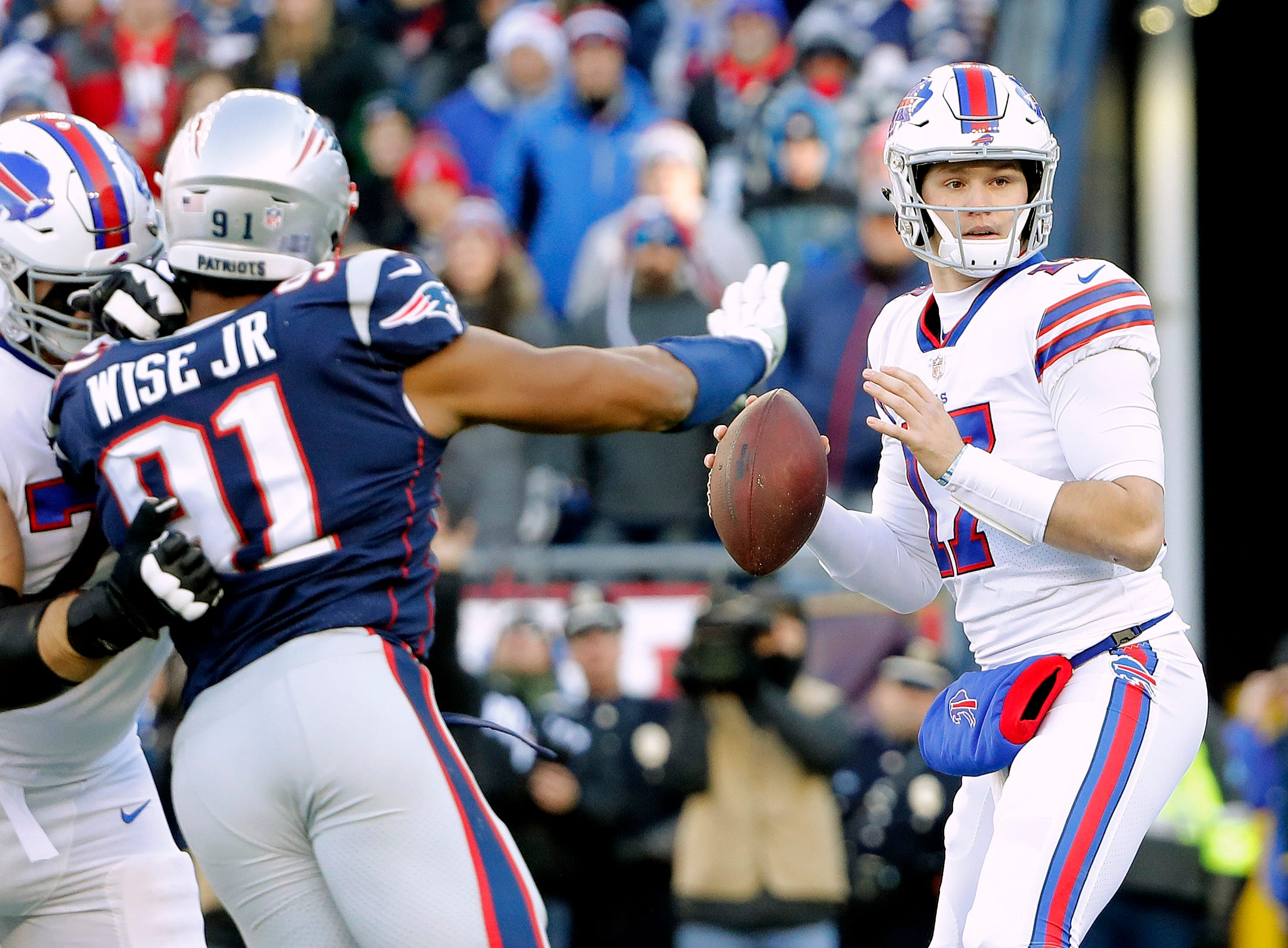 Dec 23, 2018; Foxborough, MA, USA; Buffalo Bills quarterback Josh Allen (17) looks to pass under a rush from New England Patriots defensive end Deatrich Wise (91) during the first quarter at Gillette Stadium. Mandatory Credit: Winslow Townson-USA TODAY Sports