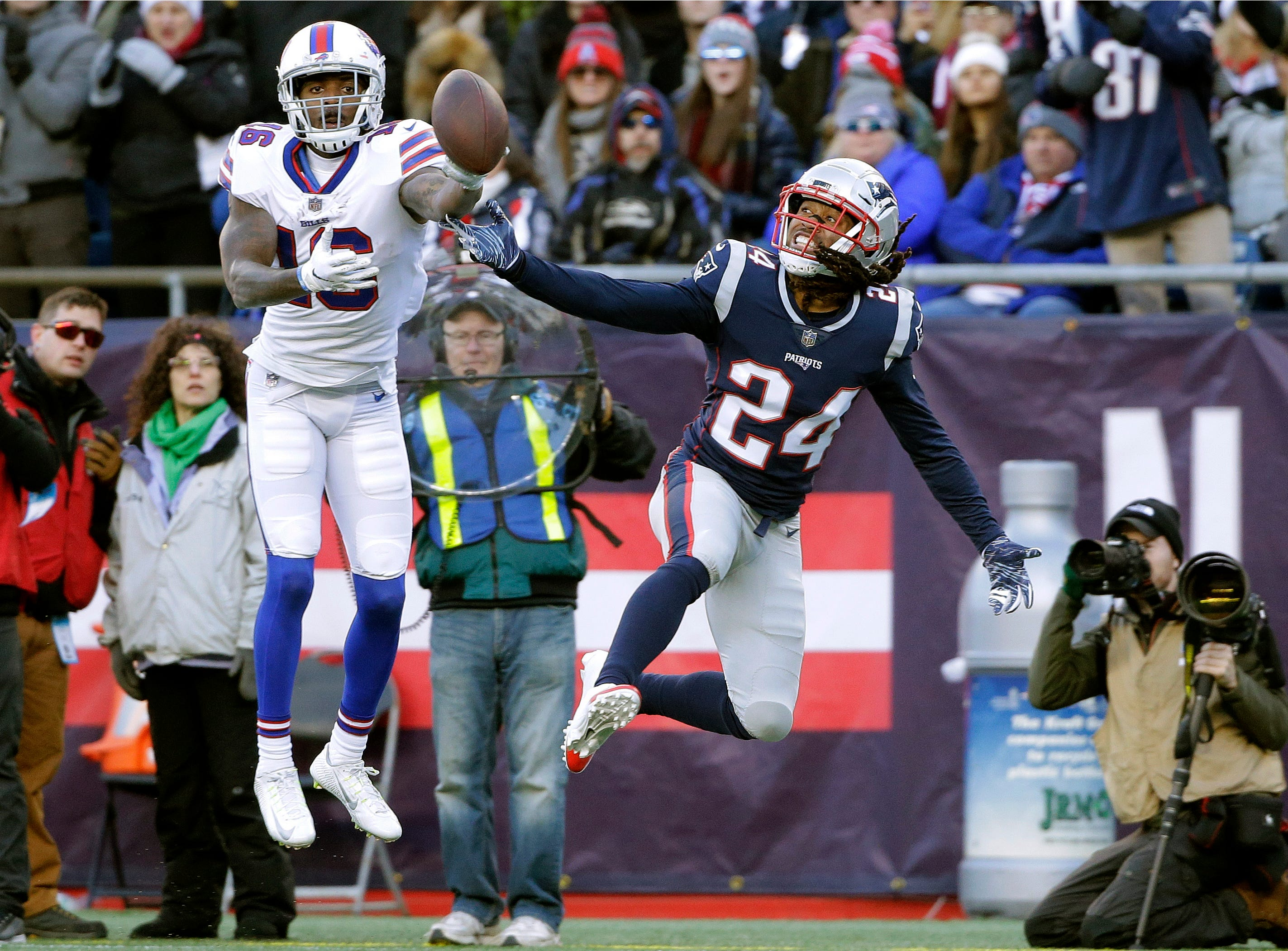 New England Patriots defensive back Stephon Gilmore, front, breaks up a pass in the end zone intended for Buffalo Bills wide receiver Robert Foster, rear, during the first half of an NFL football game, Sunday, Dec. 23, 2018, in Foxborough, Mass. (AP Photo/Steven Senne)