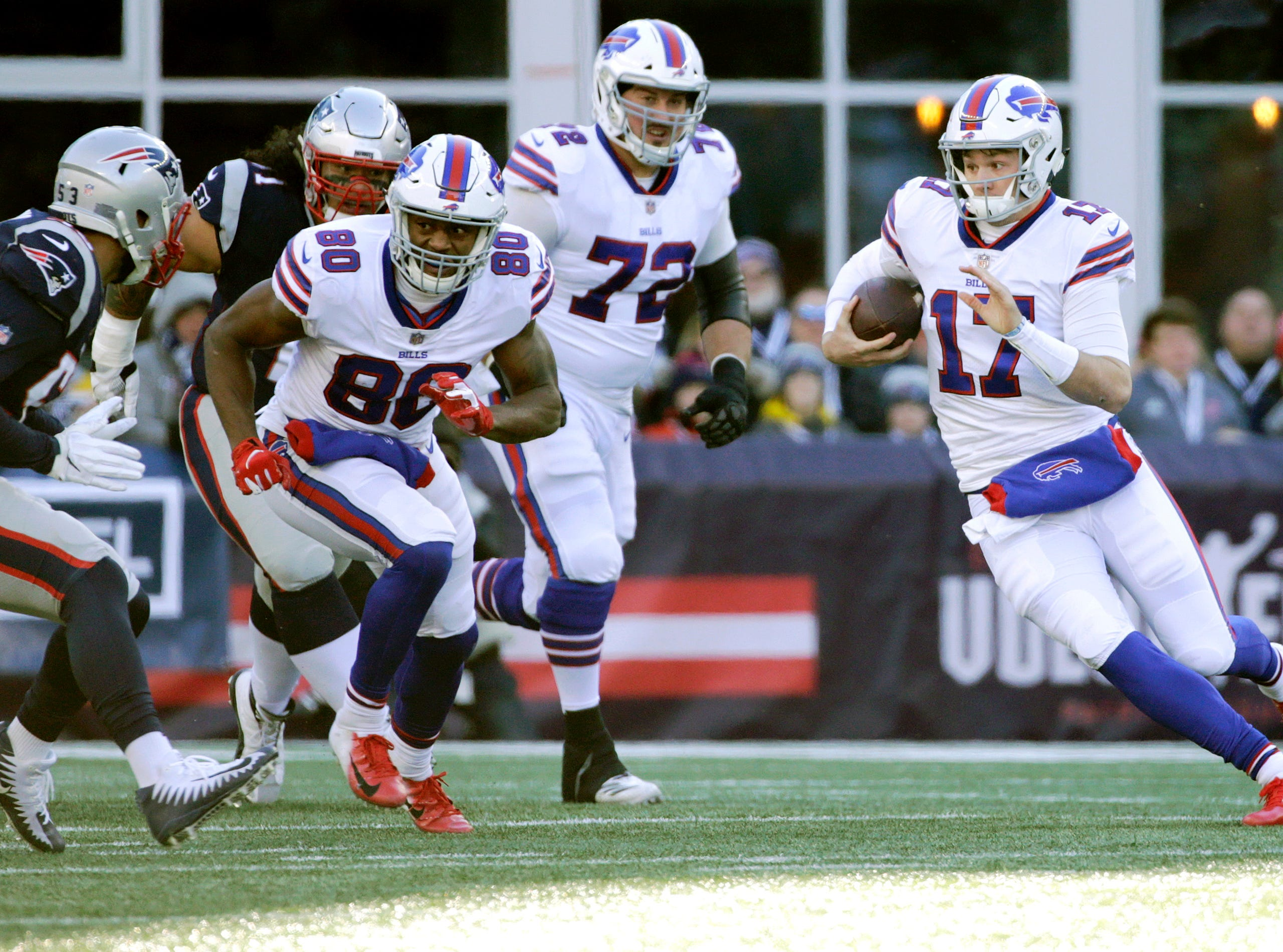 Buffalo Bills quarterback Josh Allen (17) runs against the New England Patriots during the first half of an NFL football game, Sunday, Dec. 23, 2018, in Foxborough, Mass. (AP Photo/Elise Amendola)