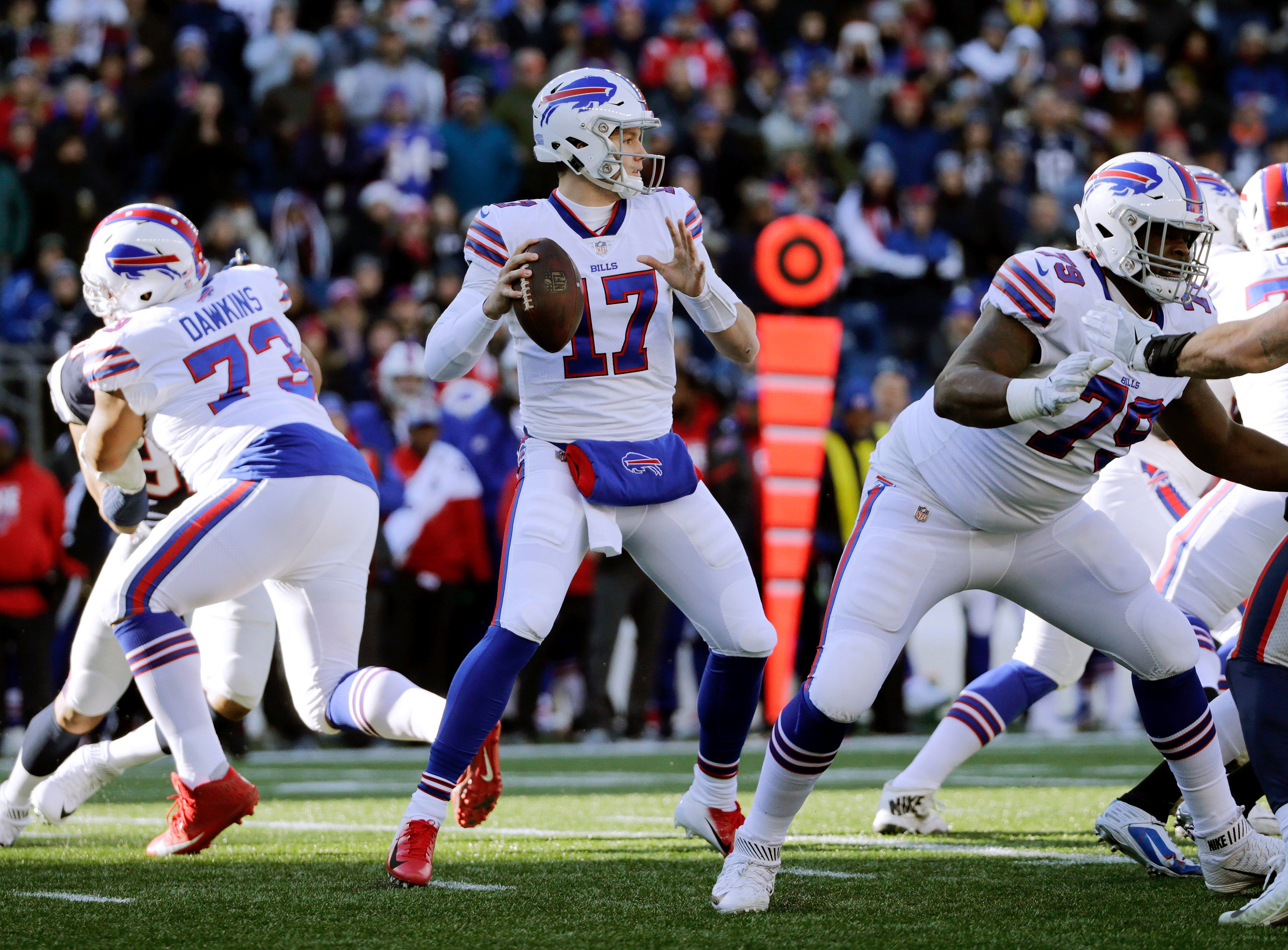 Buffalo Bills quarterback Josh Allen (17) drops back to pass against the New England Patriots during the first half of an NFL football game, Sunday, Dec. 23, 2018, in Foxborough, Mass. (AP Photo/Elise Amendola)