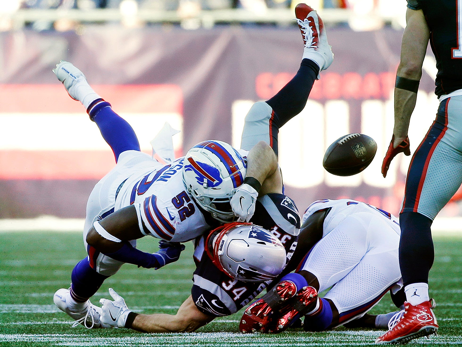 New England Patriots running back Rex Burkhead (34) fumbles on a tackle by Buffalo Bills linebacker Corey Thompson (52) during the first half of an NFL football game, Sunday, Dec. 23, 2018, in Foxborough, Mass. (AP Photo/Steven Senne)