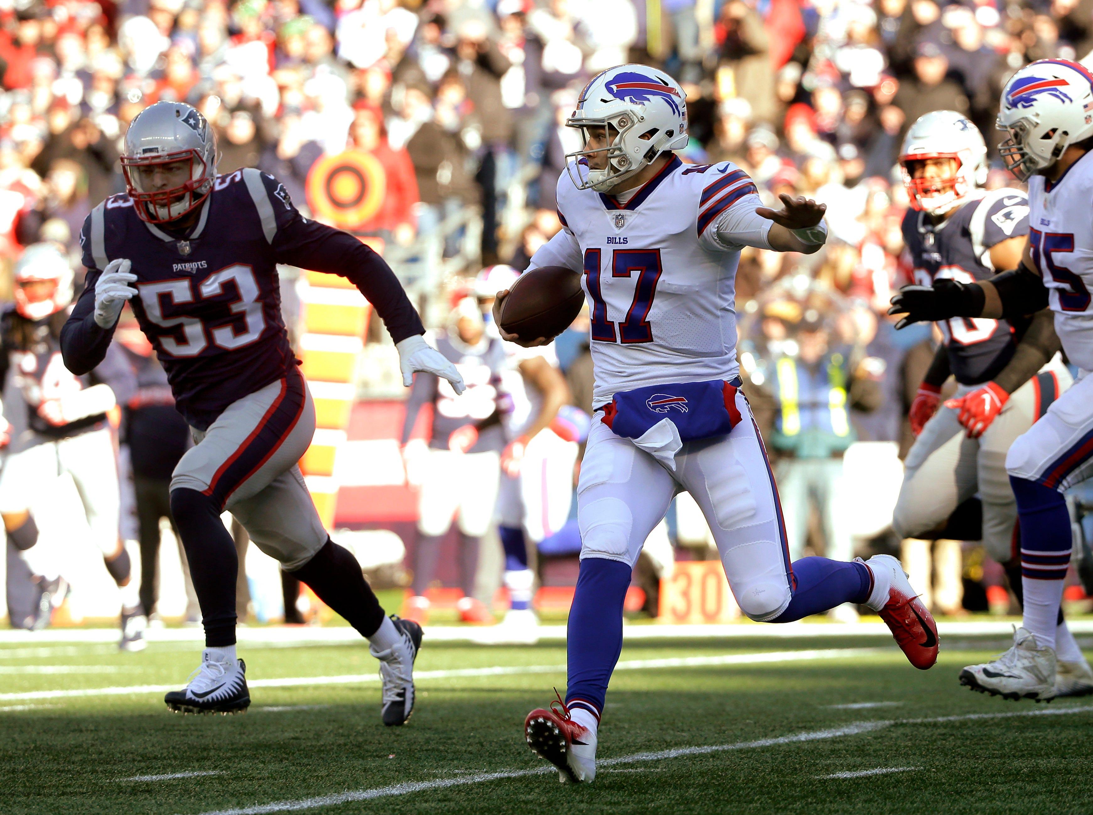 Buffalo Bills quarterback Josh Allen (17) runs from New England Patriots linebacker Kyle Van Noy (53) during the first half of an NFL football game, Sunday, Dec. 23, 2018, in Foxborough, Mass. (AP Photo/Steven Senne)