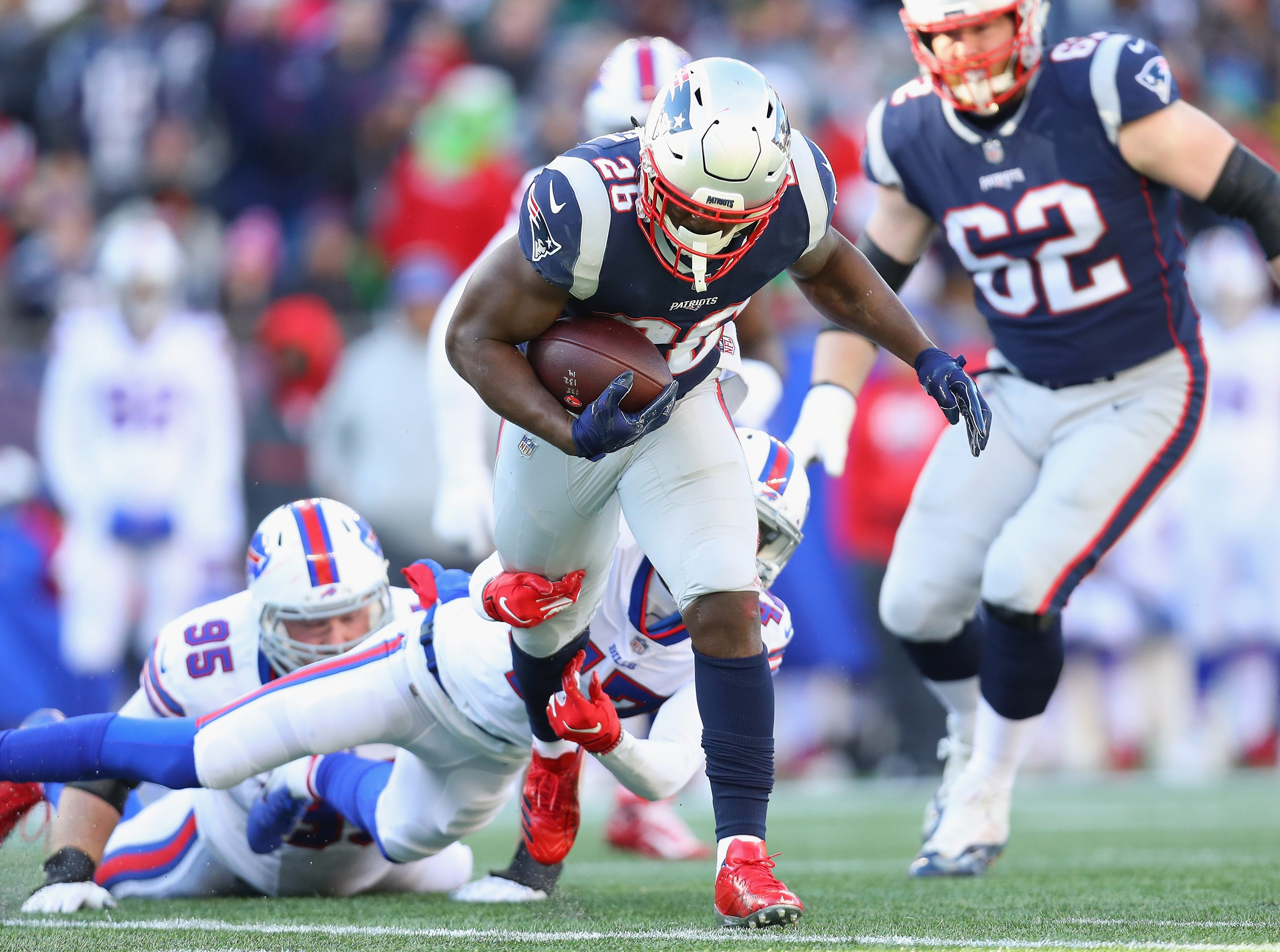 FOXBOROUGH, MA - DECEMBER 23:  Sony Michel #26 of the New England Patriots runs with the ball during the first half against the Buffalo Bills at Gillette Stadium on December 23, 2018 in Foxborough, Massachusetts.  (Photo by Maddie Meyer/Getty Images)
