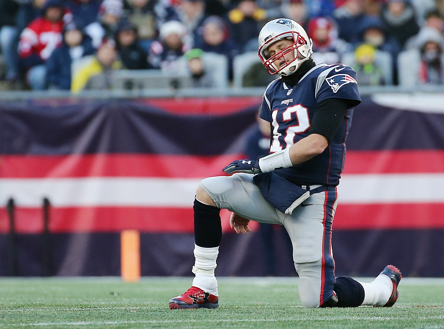 FOXBOROUGH, MA - DECEMBER 23:  Tom Brady #12 of the New England Patriots reacts during the second half against the Buffalo Bills at Gillette Stadium on December 23, 2018 in Foxborough, Massachusetts.  (Photo by Jim Rogash/Getty Images)