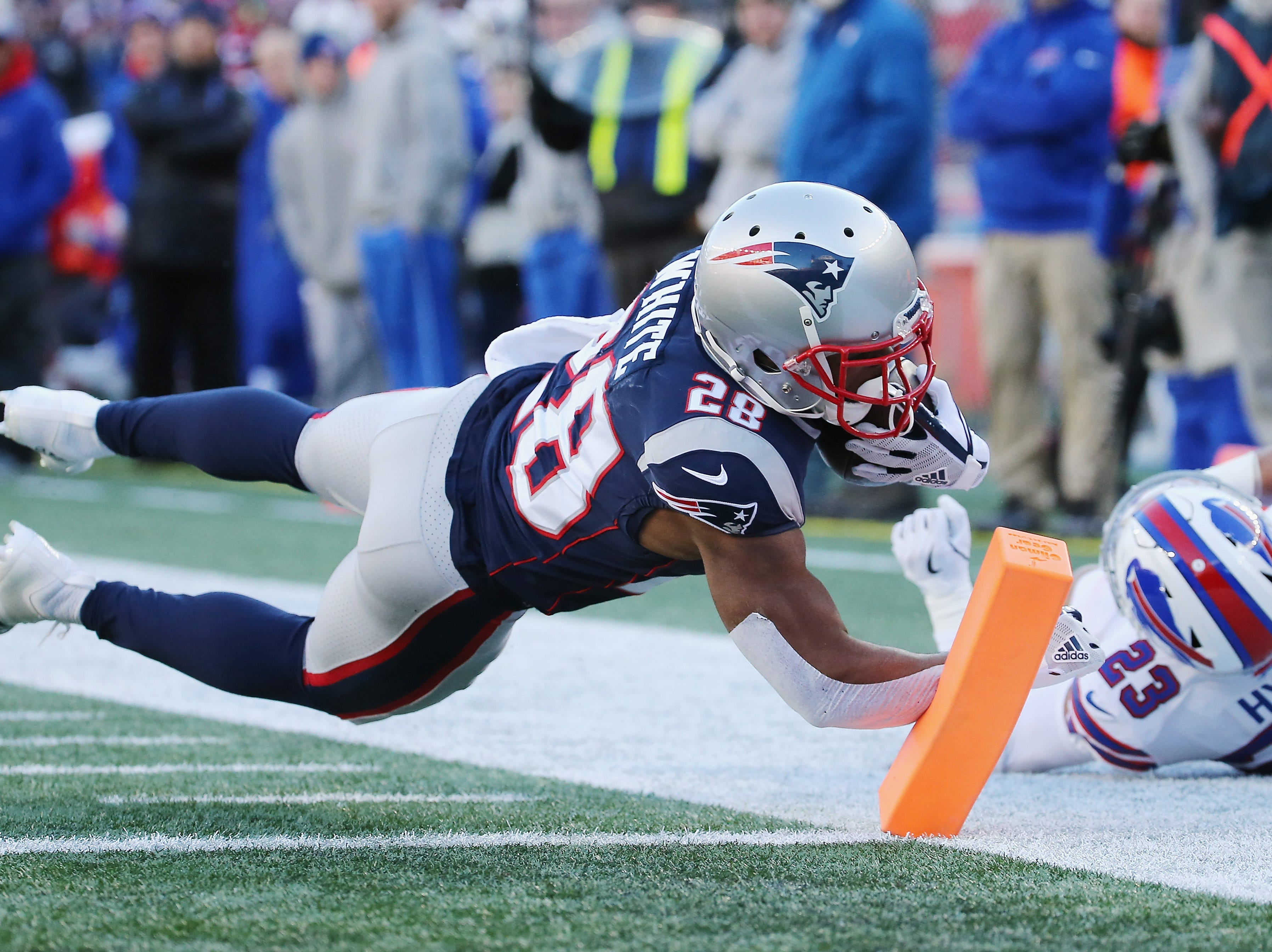 FOXBOROUGH, MA - DECEMBER 23:  James White #28 of the New England Patriots rushes for a 27-yard touchdown during the second quarter against the Buffalo Bills at Gillette Stadium on December 23, 2018 in Foxborough, Massachusetts.  (Photo by Jim Rogash/Getty Images)