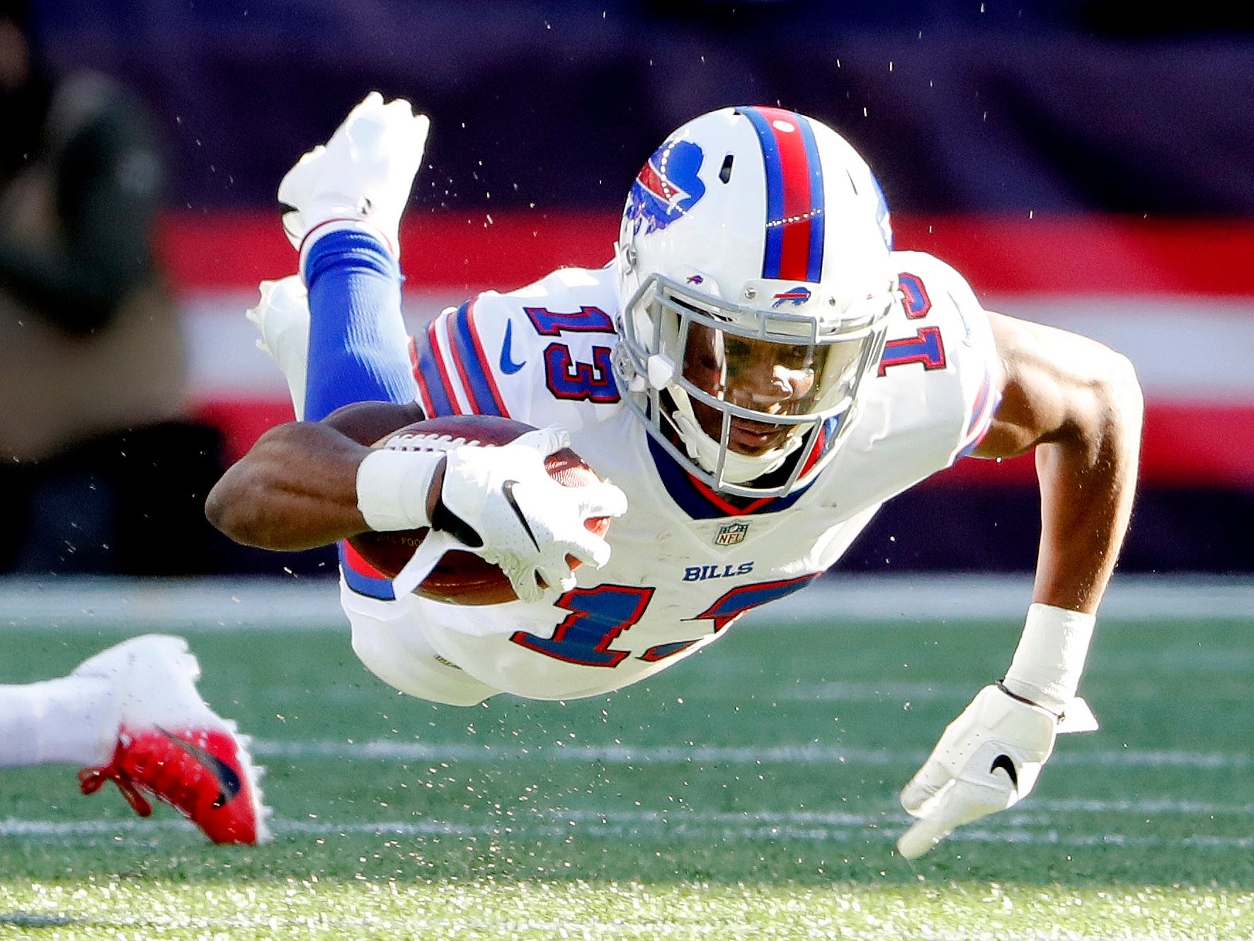 Dec 23, 2018; Foxborough, MA, USA; Buffalo Bills receiver Victor Bolden Jr. is sent flying during the opening kick off during the first quarter against the New England Patriots at Gillette Stadium. Mandatory Credit: Winslow Townson-USA TODAY Sports