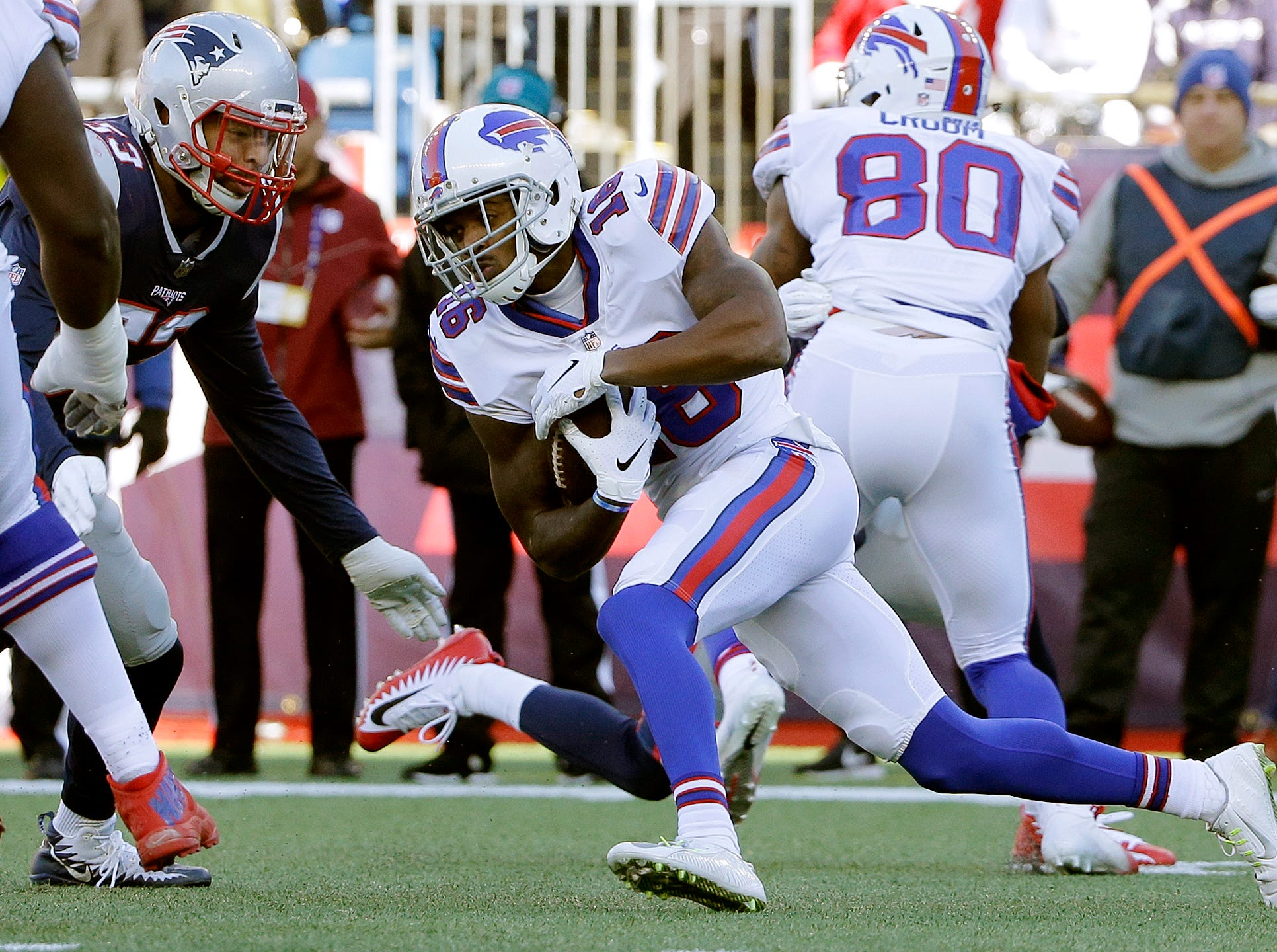 New England Patriots linebacker Kyle Van Noy, left, closes in to tackle Buffalo Bills wide receiver Robert Foster during the first half of an NFL football game, Sunday, Dec. 23, 2018, in Foxborough, Mass. (AP Photo/Steven Senne)