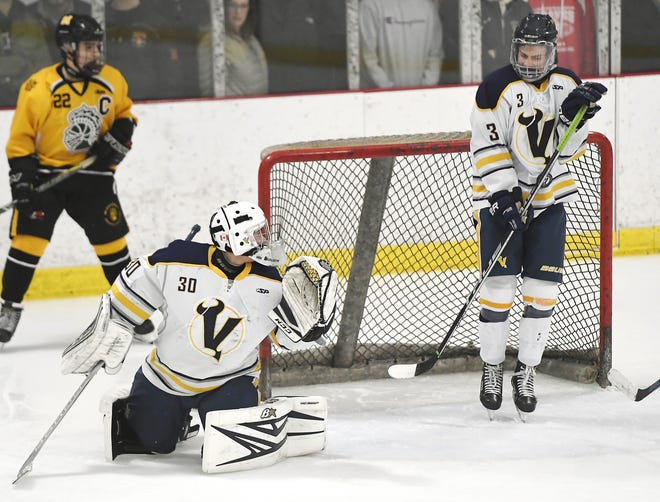 Victor's Josh Albert, right, takes a puck to his stomach on a shot that got past goalie Pieter Bartelse (30) during a regular season game played at the Rochester Ice Center, Saturday, Dec. 22, 2018.