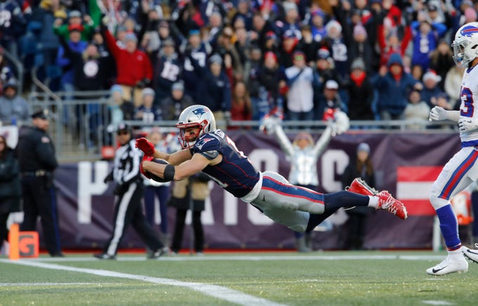 Dec 23, 2018; Foxborough, MA, USA; New England Patriots wide receiver Julian Edelman (11) dives for the touchdown against the Buffalo Bills in the third quarter at Gillette Stadium. Mandatory Credit: David Butler II-USA TODAY Sports