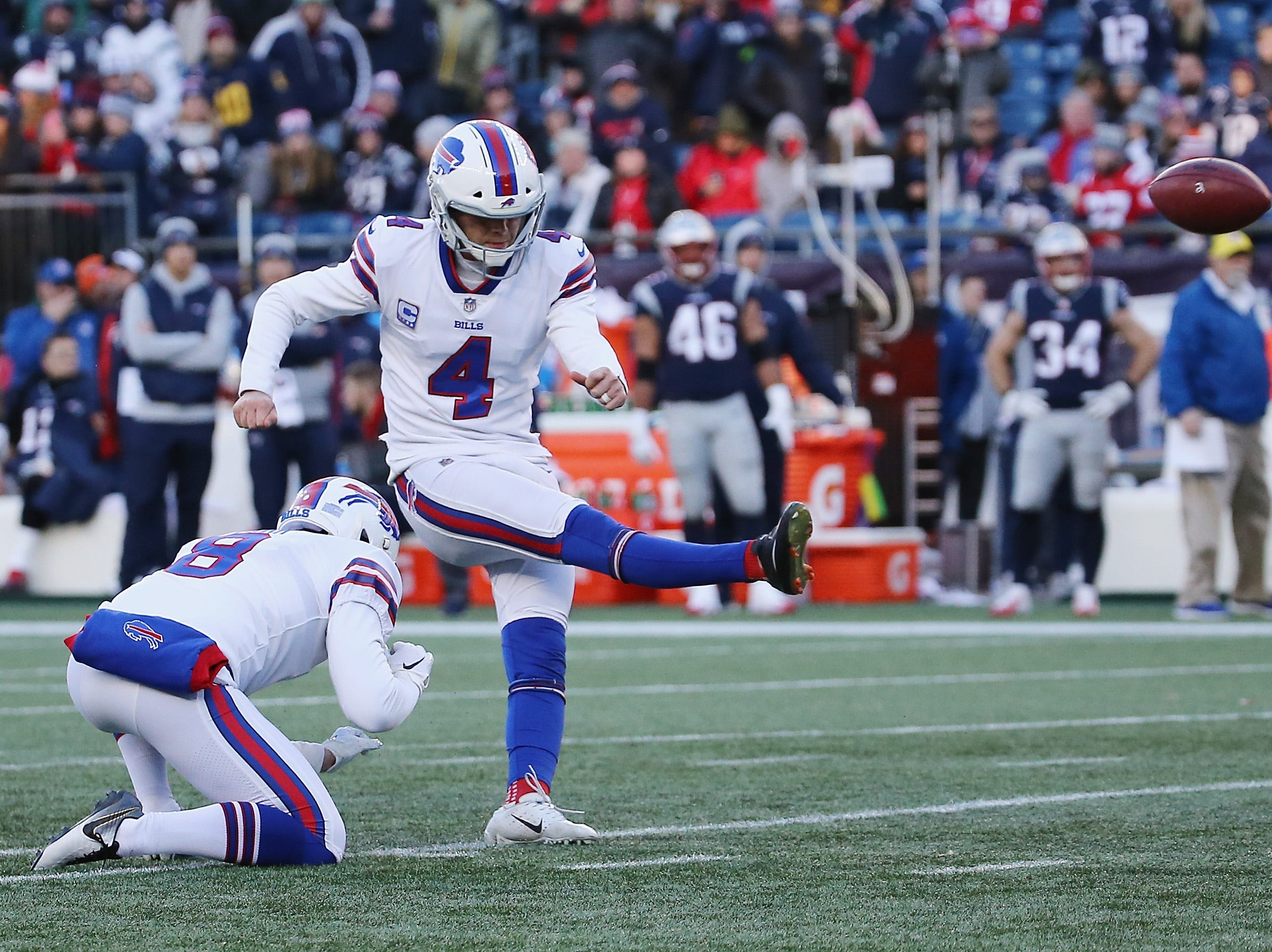 FOXBOROUGH, MA - DECEMBER 23:  Stephen Hauschka #4 of the Buffalo Bills kicks a field goal during the third quarter against the New England Patriots at Gillette Stadium on December 23, 2018 in Foxborough, Massachusetts.  (Photo by Jim Rogash/Getty Images)