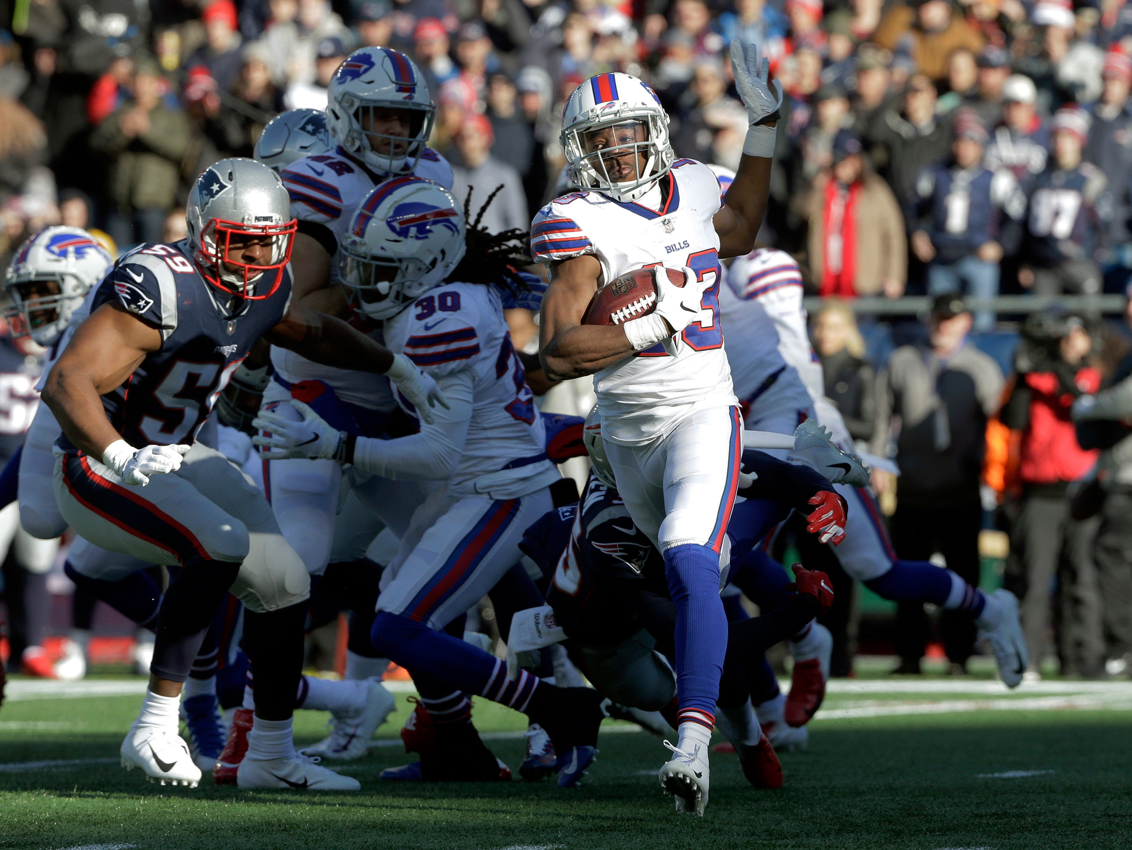 Buffalo Bills' Victor Bolden (13) returns the opening kickoff as New England Patriots linebacker Albert McClellan (59) gives chase during the first half of an NFL football game, Sunday, Dec. 23, 2018, in Foxborough, Mass. (AP Photo/Steven Senne)