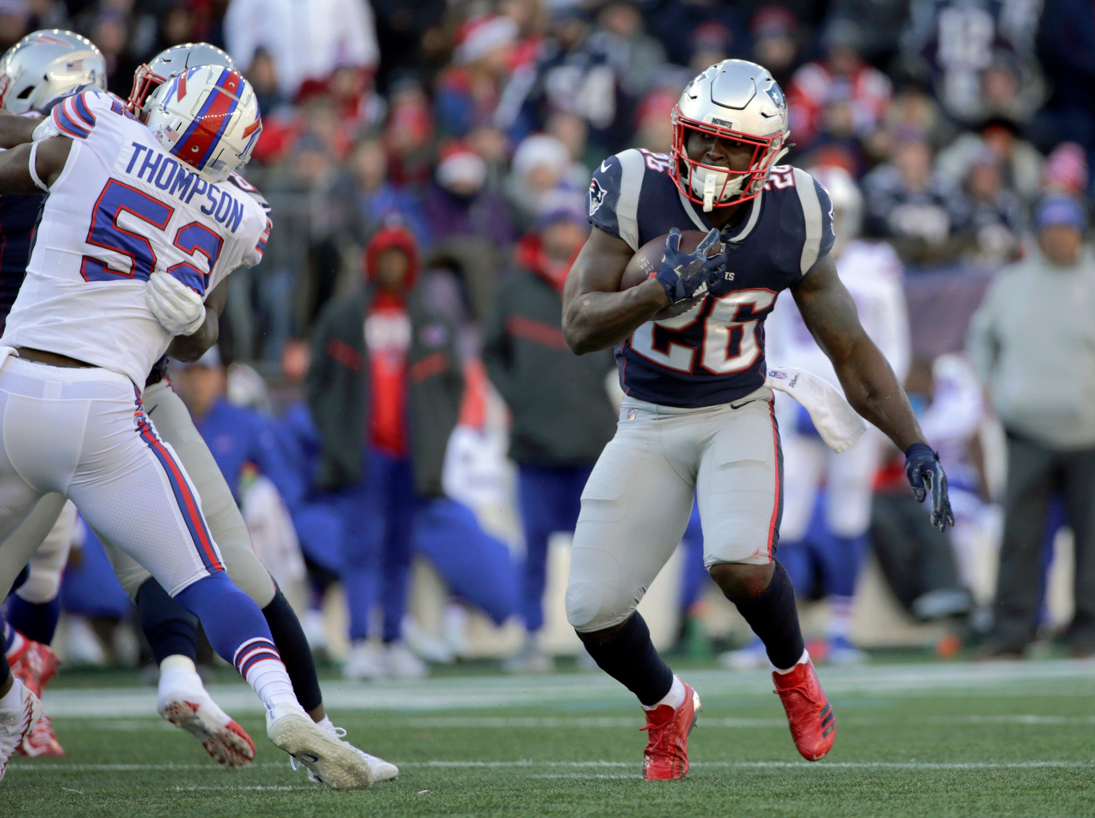 New England Patriots running back Sony Michel gains yardage against the Buffalo Bills during the first half of an NFL football game, Sunday, Dec. 23, 2018, in Foxborough, Mass. (AP Photo/Elise Amendola)